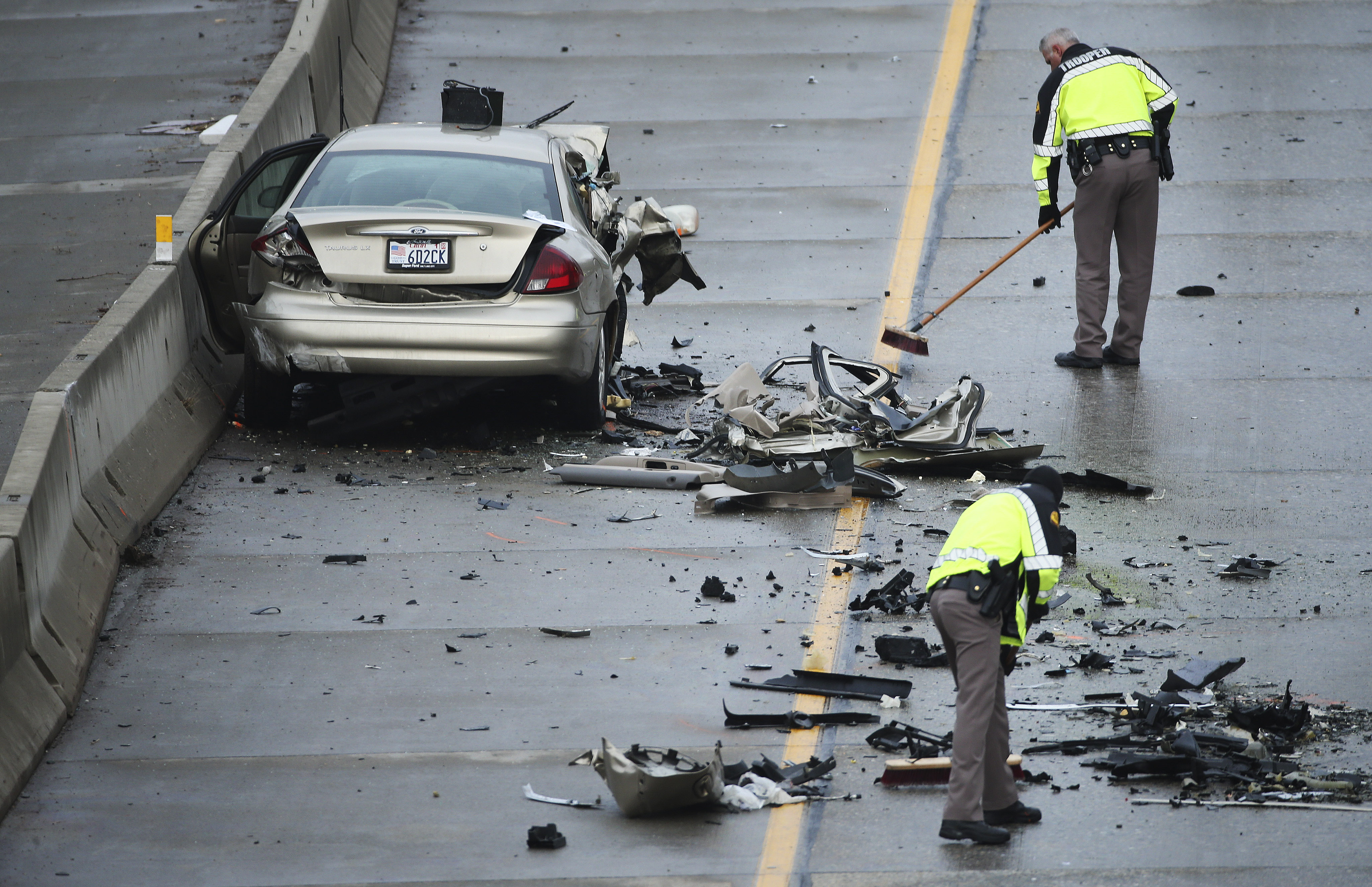 Utah Highway Patrol troops clean up after a double fatal accident due to a wrong-way driver on I-215 near2000 East in Cottonwood Heights on Friday, Jan. 24, 2020.