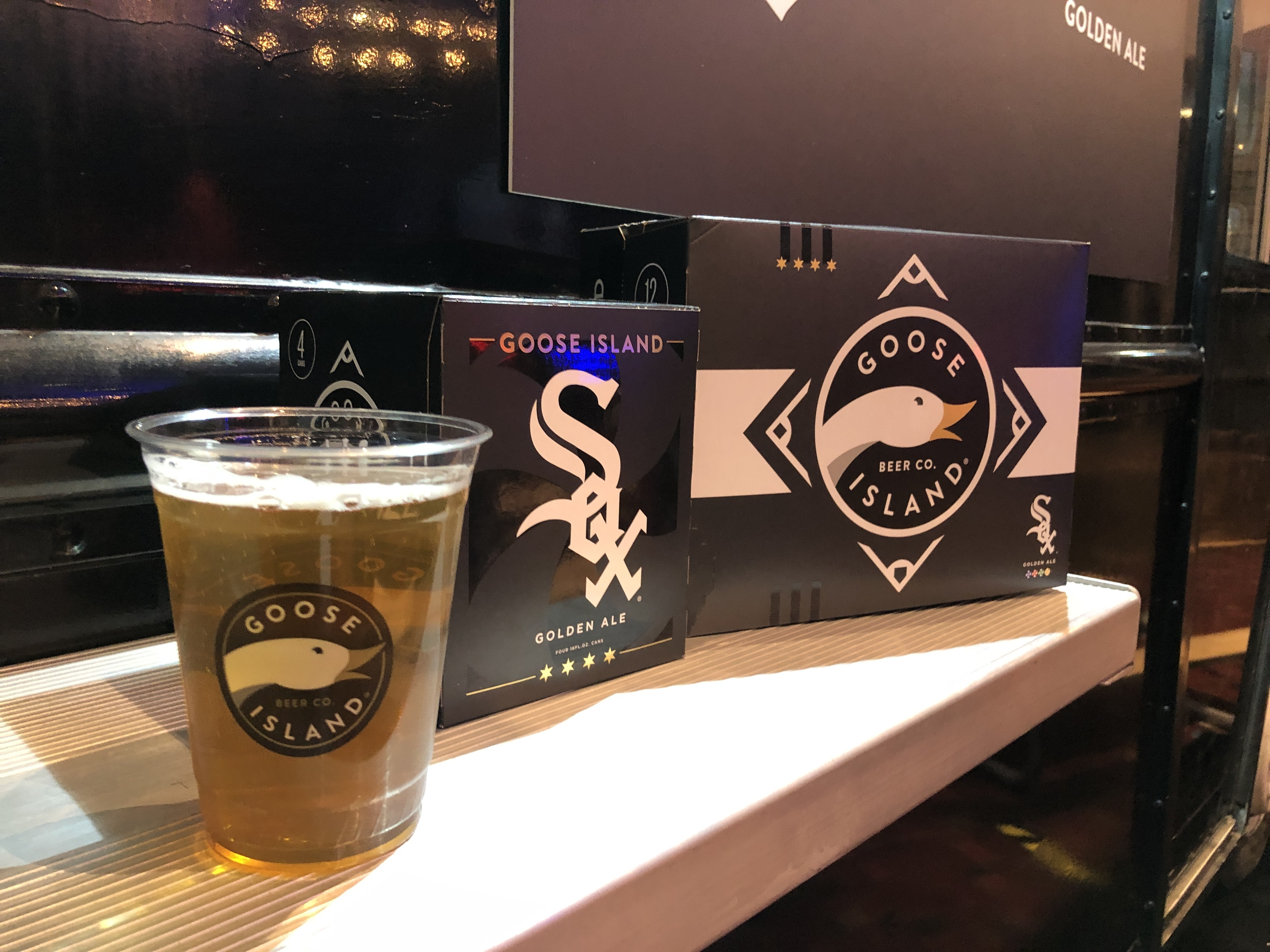 Cups, cases, and boxes of Goose Island's new White Sox beer.