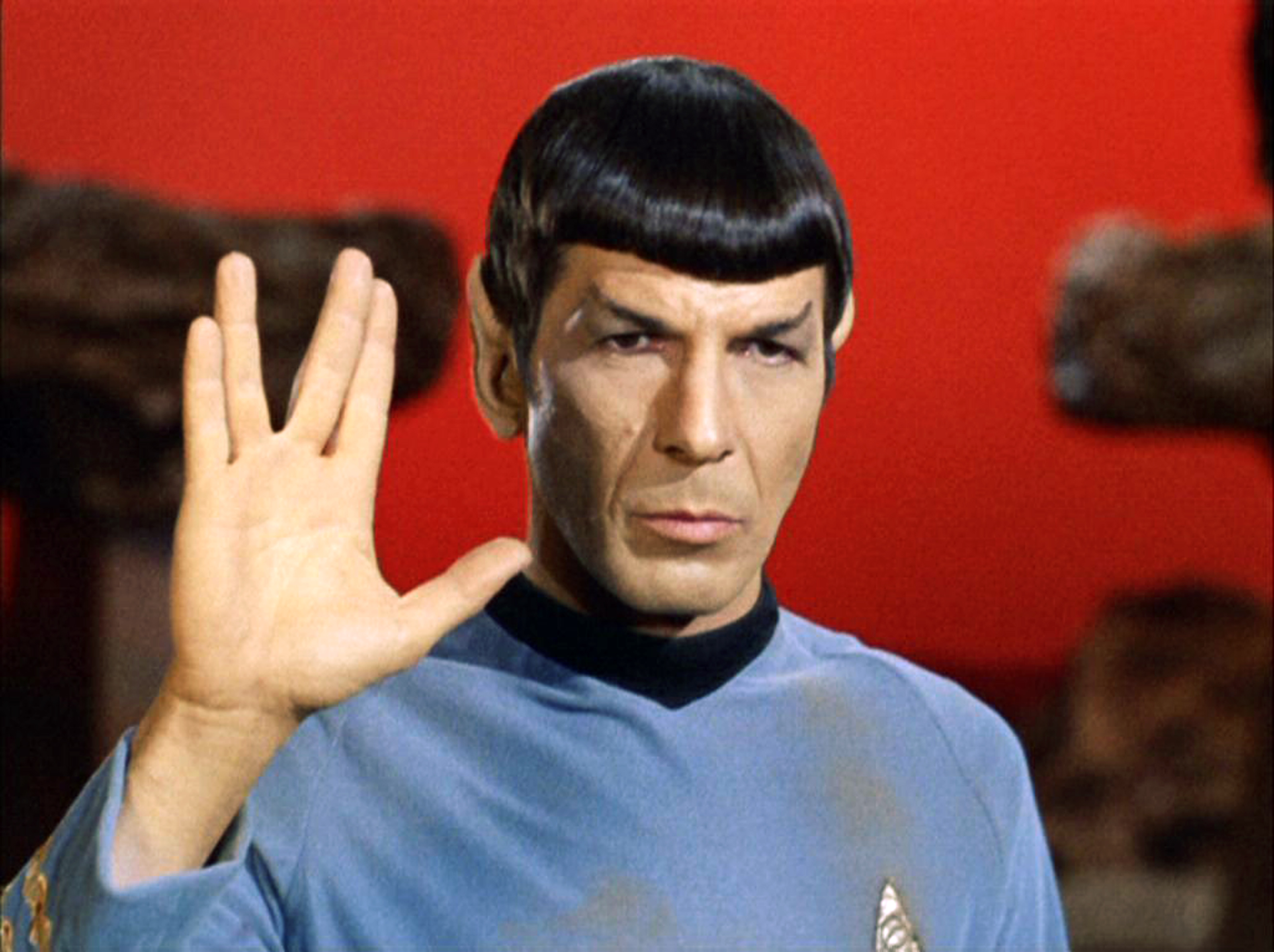 "Mr. Spock making the ""live long and prosper"" sign with his right hand."