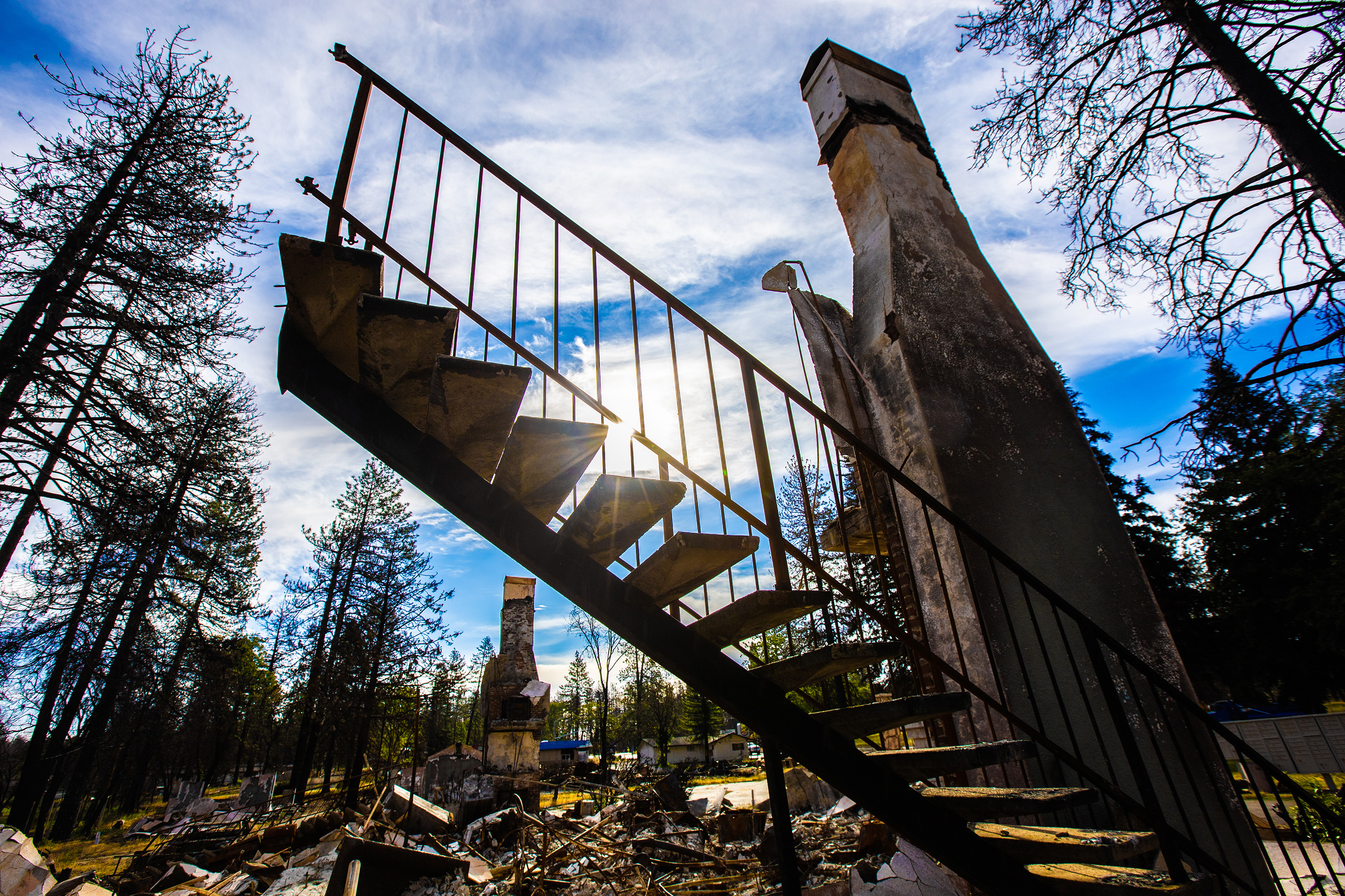 Paradise, CA where widfires have destroyed a house but the stairs are intact