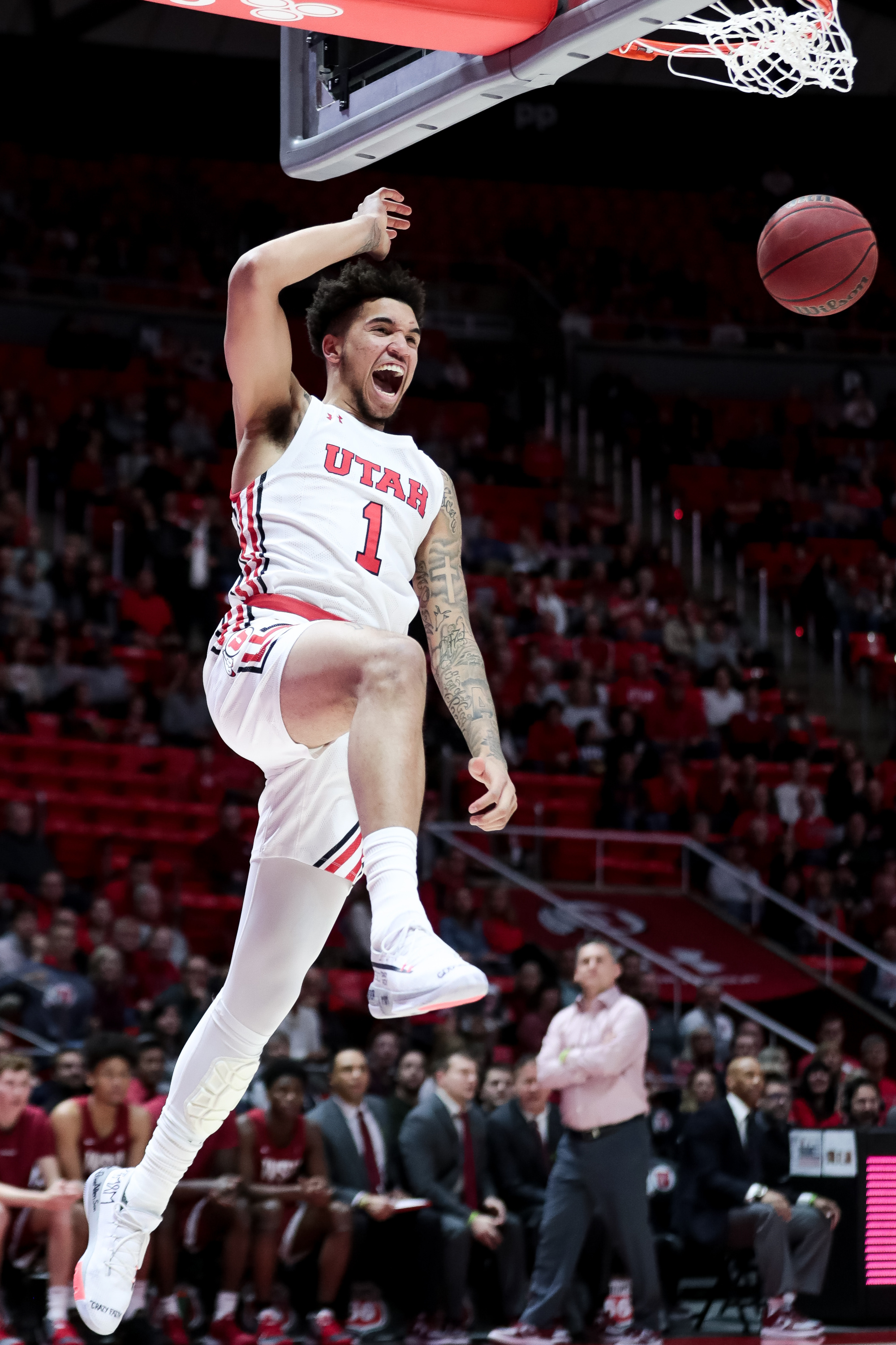 Utah Utes forward Timmy Allen (1) dunks on a breakaway during the game against the Washington State Cougars at the Huntsman Center in Salt Lake City on Saturday, Jan. 25, 2020.