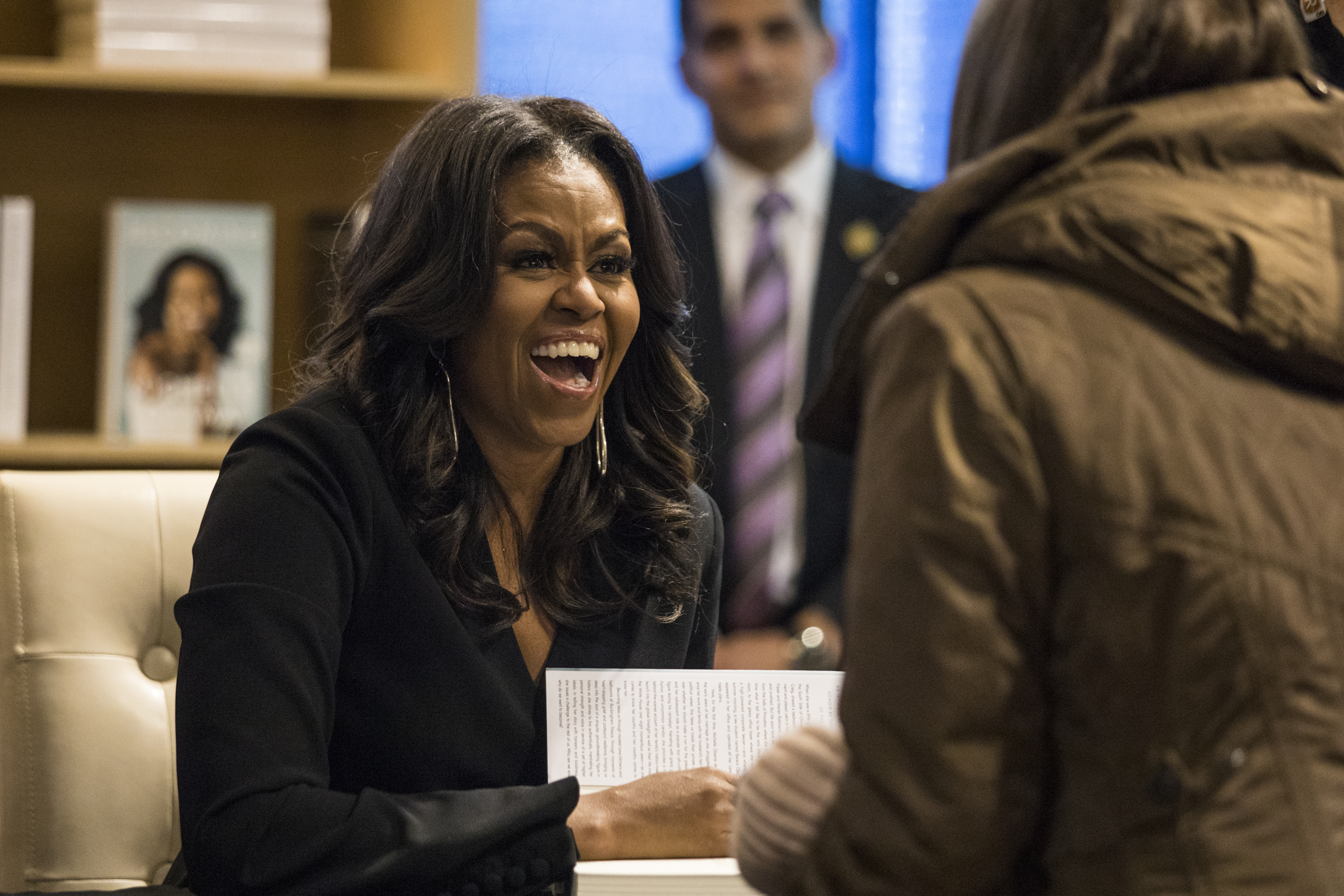 "Former First Lady Michelle Obama signs copies of her new book ""Becoming"" and greets fans at Seminary Co-op Bookstore in Chicago, Tuesday afternoon, Nov. 13, 2018."