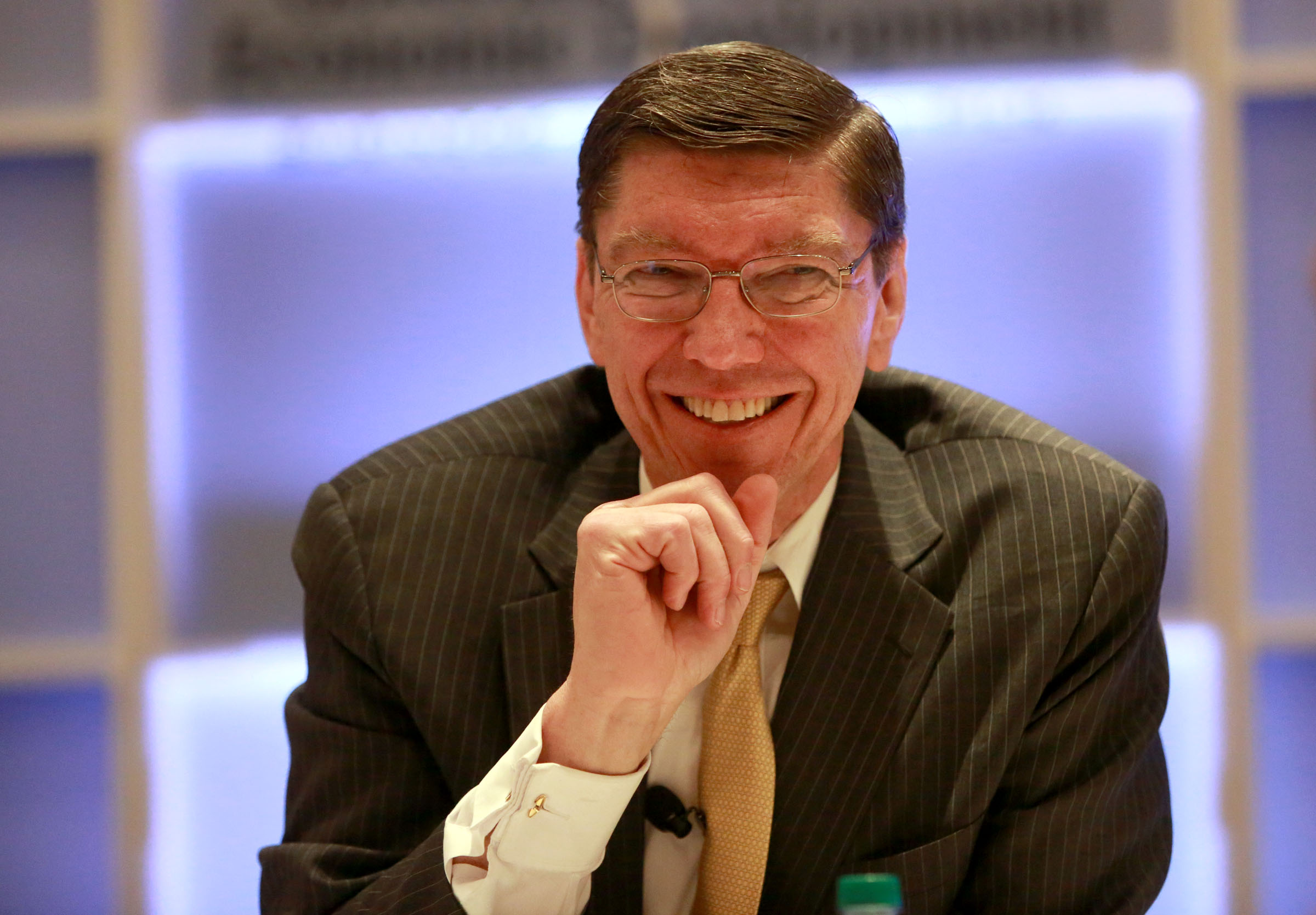 FILE - Clayton Christensen talks to people after giving his keynote speech at the Governor's Utah Economic Summit at the Grand America Hotel in Salt Lake City on Thursday, April 3, 2014.