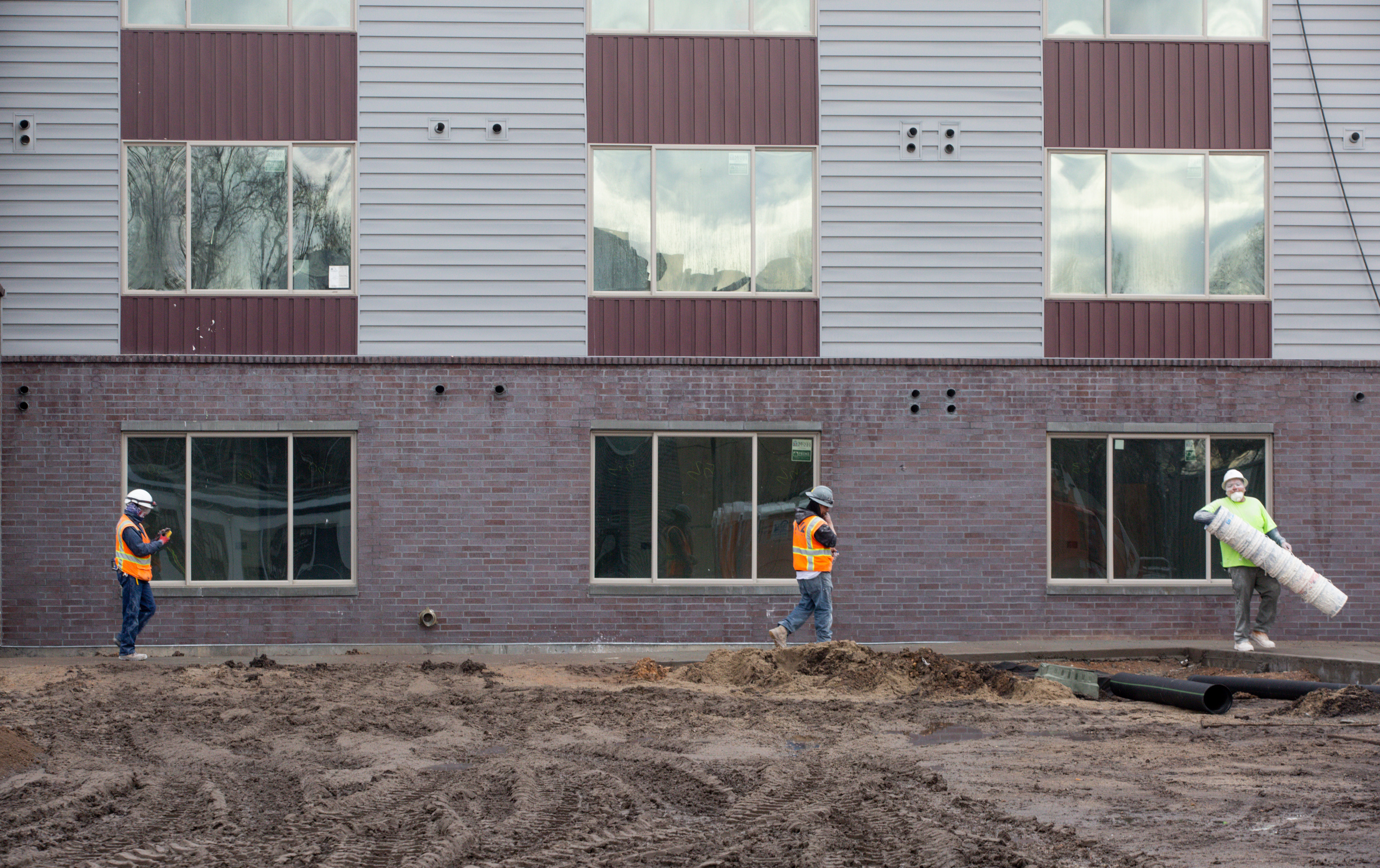 Construction crews work on an affordable housing building at 500 West and 400 North in Salt Lake City on Friday, Jan. 24, 2020. The five-story building will have a total of 74 units including eight live/work spaces. The rest will be one-bedroom studios.