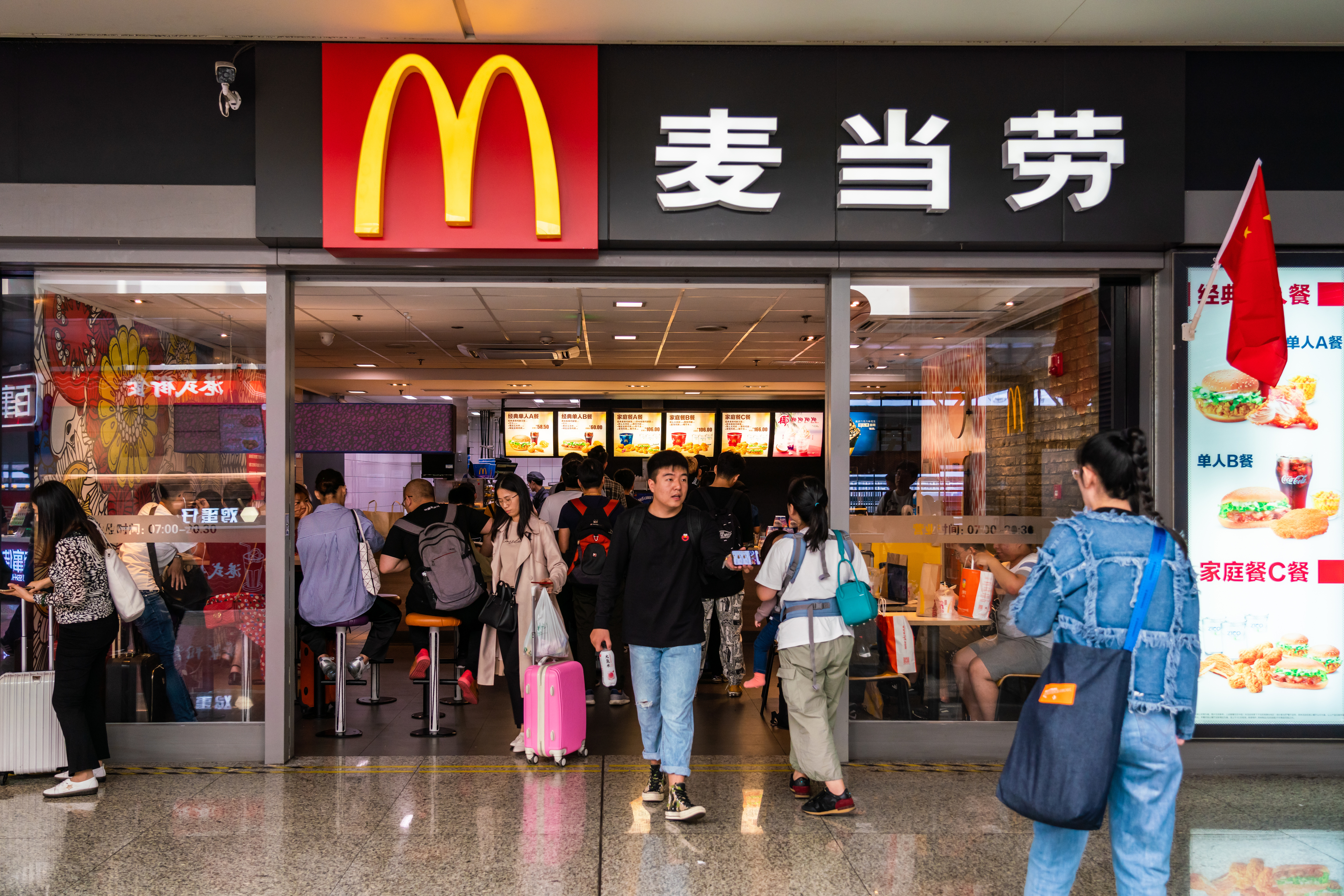 Customers walk in an out of a McDonald's in Shanghai.