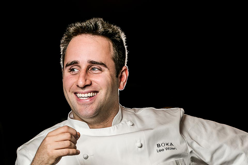 A headshot of a white male chef in a white chefs coat.