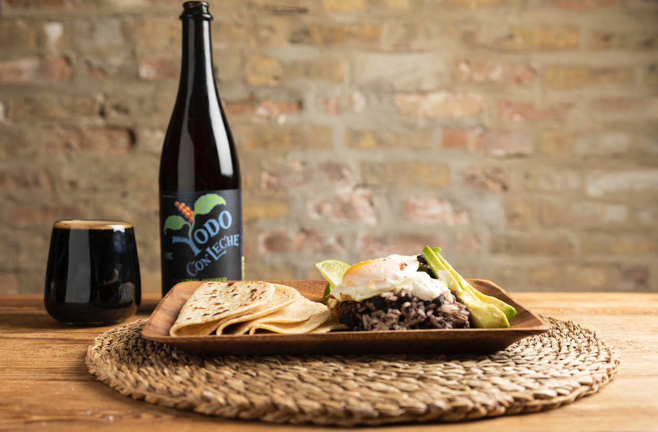 A bomber of beer, beer in a glass, and tortillas and more.