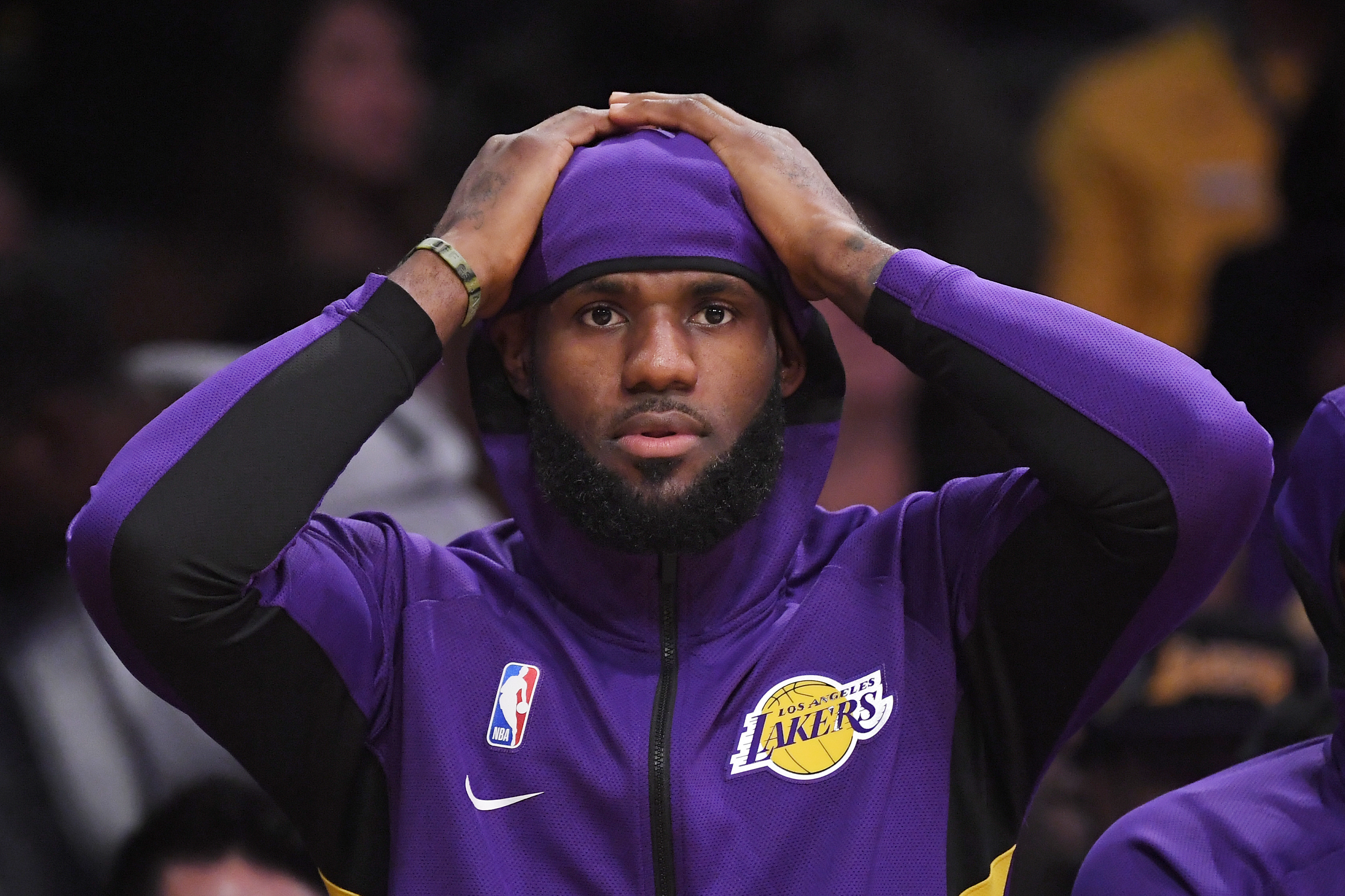 Los Angeles Lakers forward LeBron James sits on the bench during the first half of a preseason NBA basketball game against the Golden State Warriors, Monday, Oct. 14, 2019, in Los Angeles. (AP Photo/Mark J. Terrill)