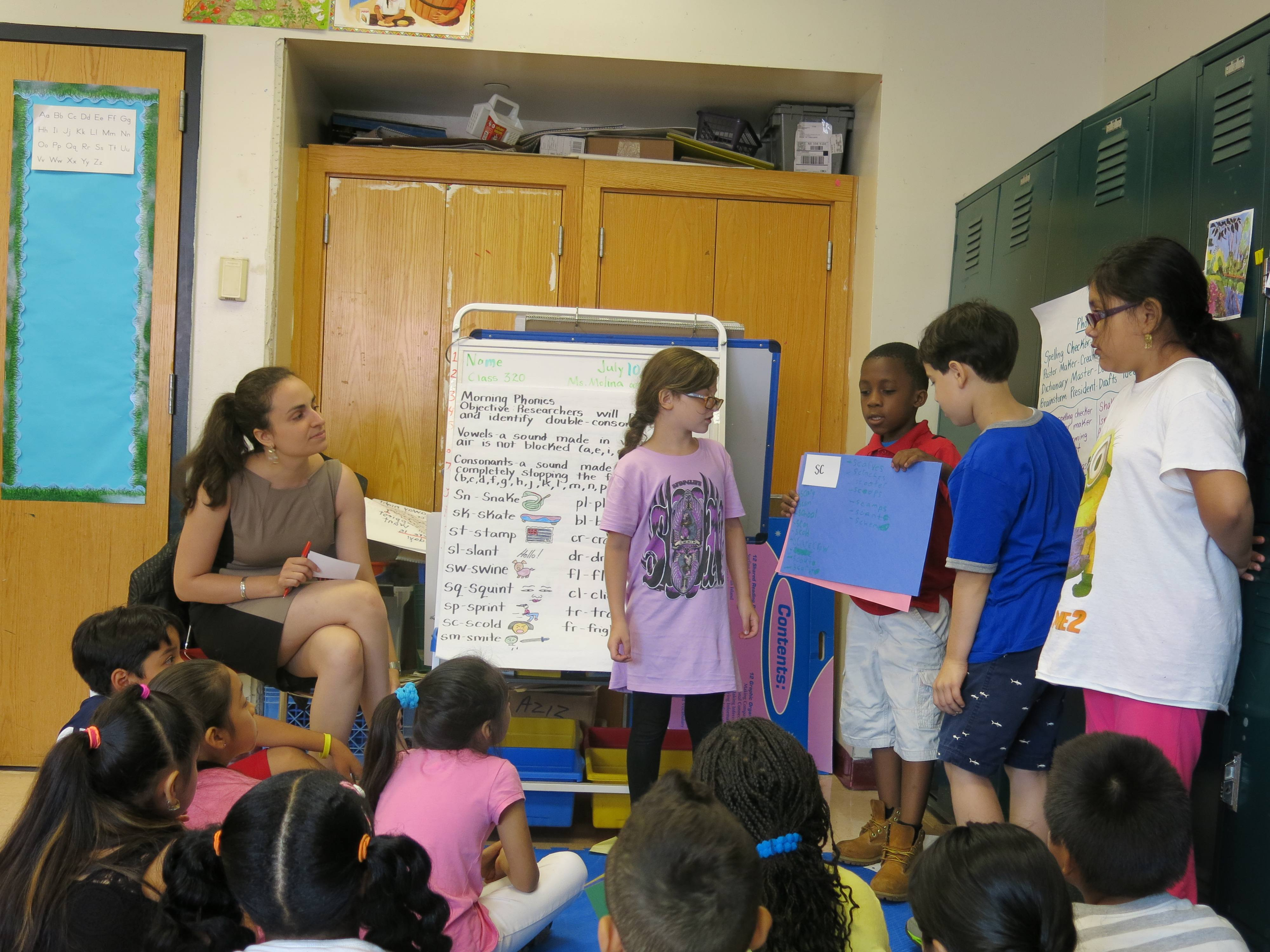 Students at the BELL-P.S./I.S. 218 Summer Quest site present their phonics work to the class.