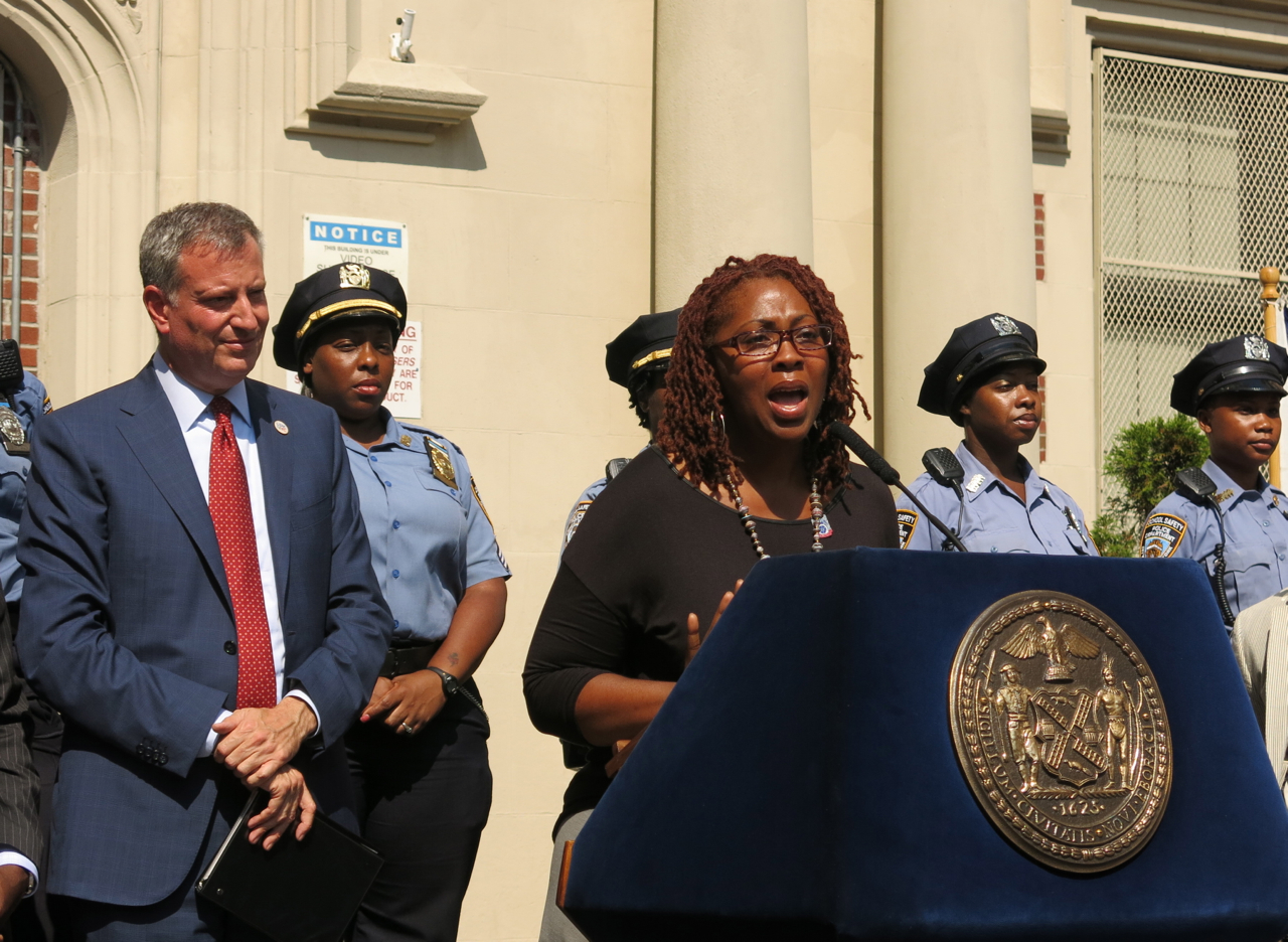School safety agent Kangela Moore speaks in favor of a tentative contract agreement between the city and her union.