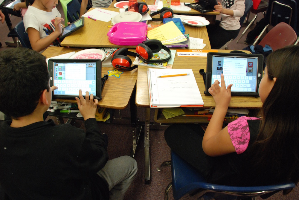 Students at Edgewater Elementary School in Jefferson County work on iPads during class.