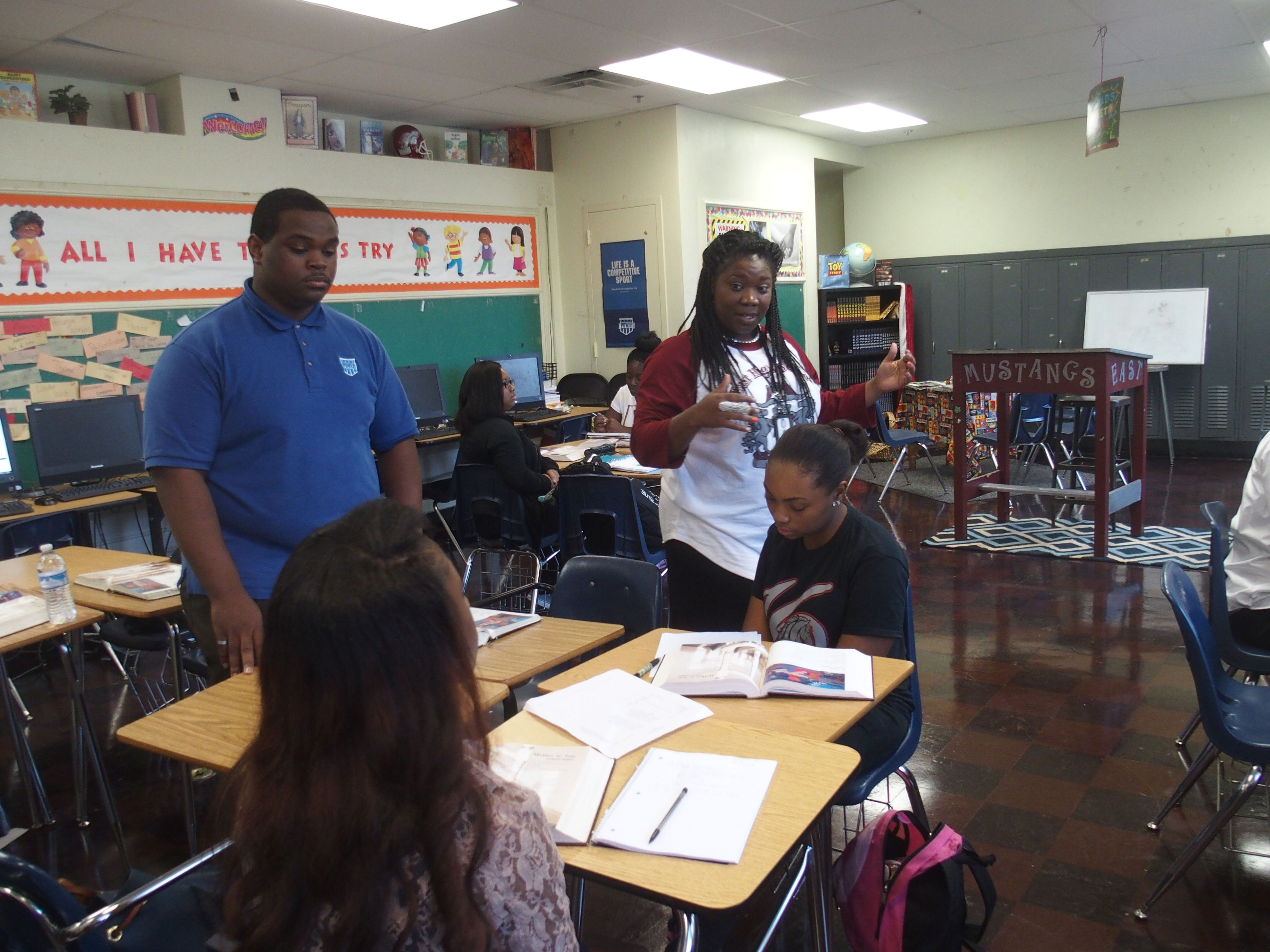 Teacher Meah King (center) introduces curriculum to her students on Monday on the first day of class at East High School in Memphis.