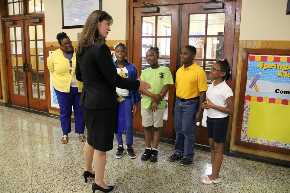 Tennessee Education Commissioner Candice McQueen is greeted by students and staff at Springdale Memphis Magnet Elementary School during a 2015 svisit.