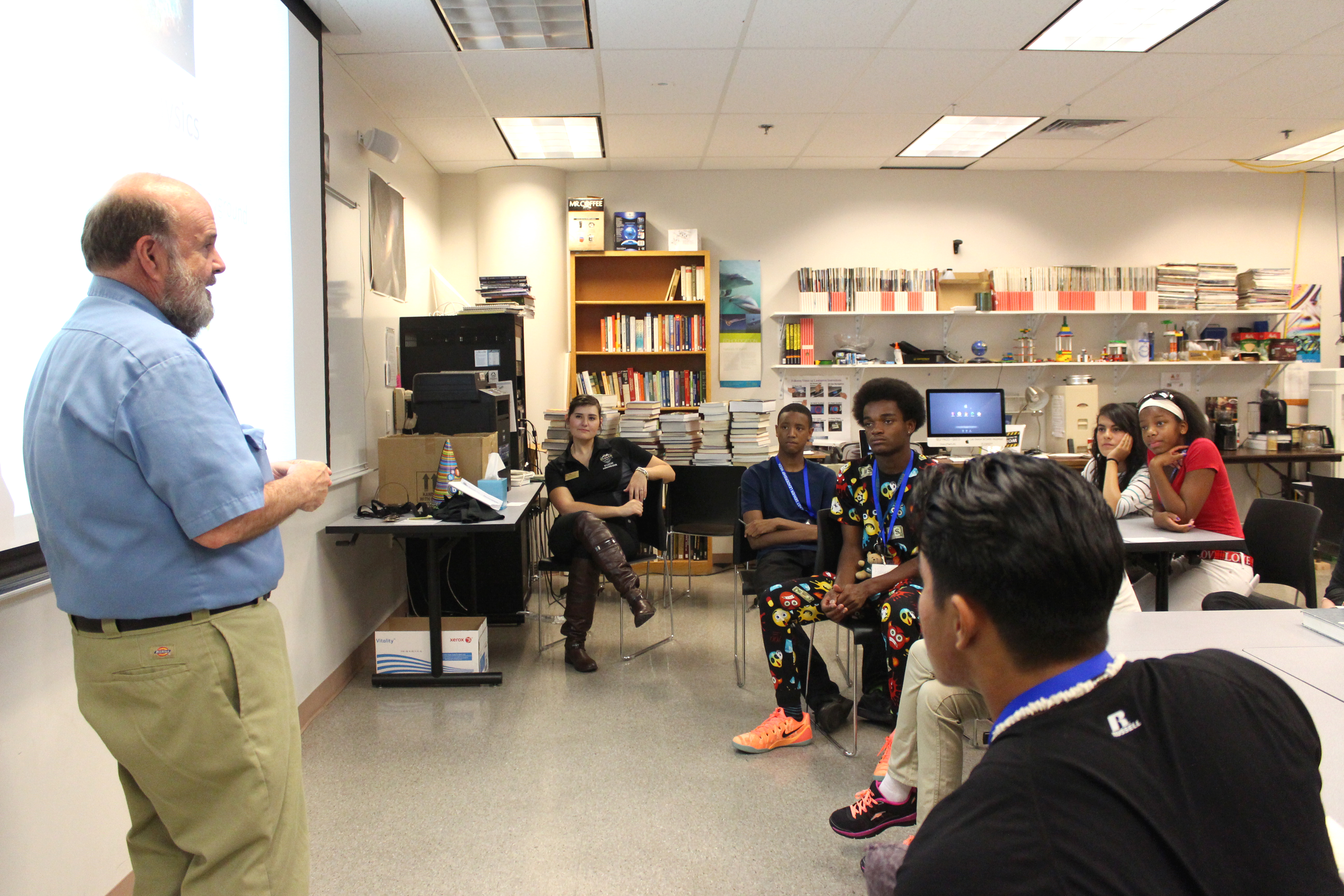 Students look on as a CU Denver physics instructor talks to them about physics and space. Physics was one of six majors students could explore during breakout sessions.