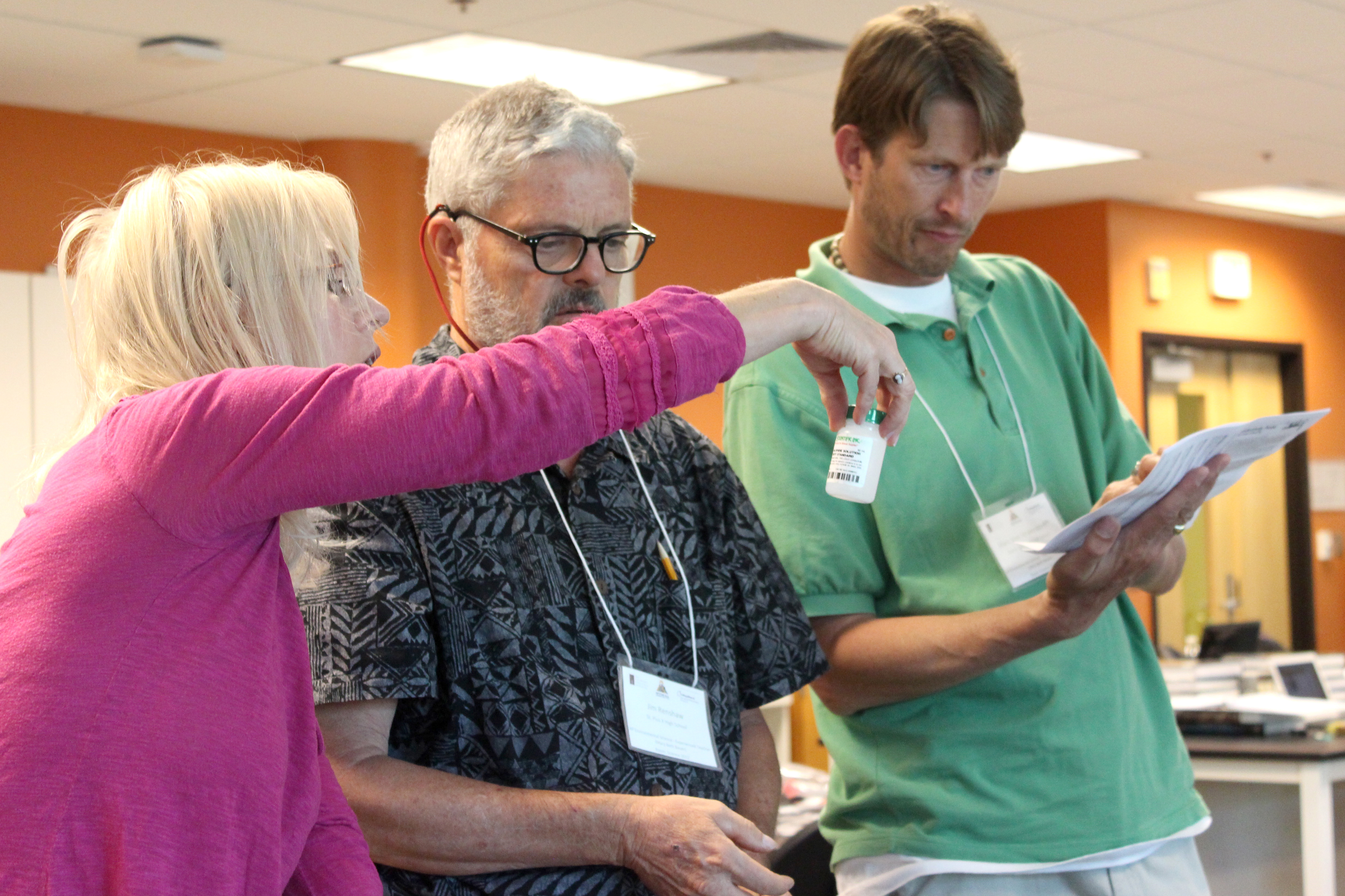 Three AP environmental science teachers work together on a lab assignment their students could do during the school year. At the AP for All Summer Institute, about 500 teachers showed up to  the Metropolitan State University of Denver to learn about new teaching techniques to entice more kids to take AP courses.