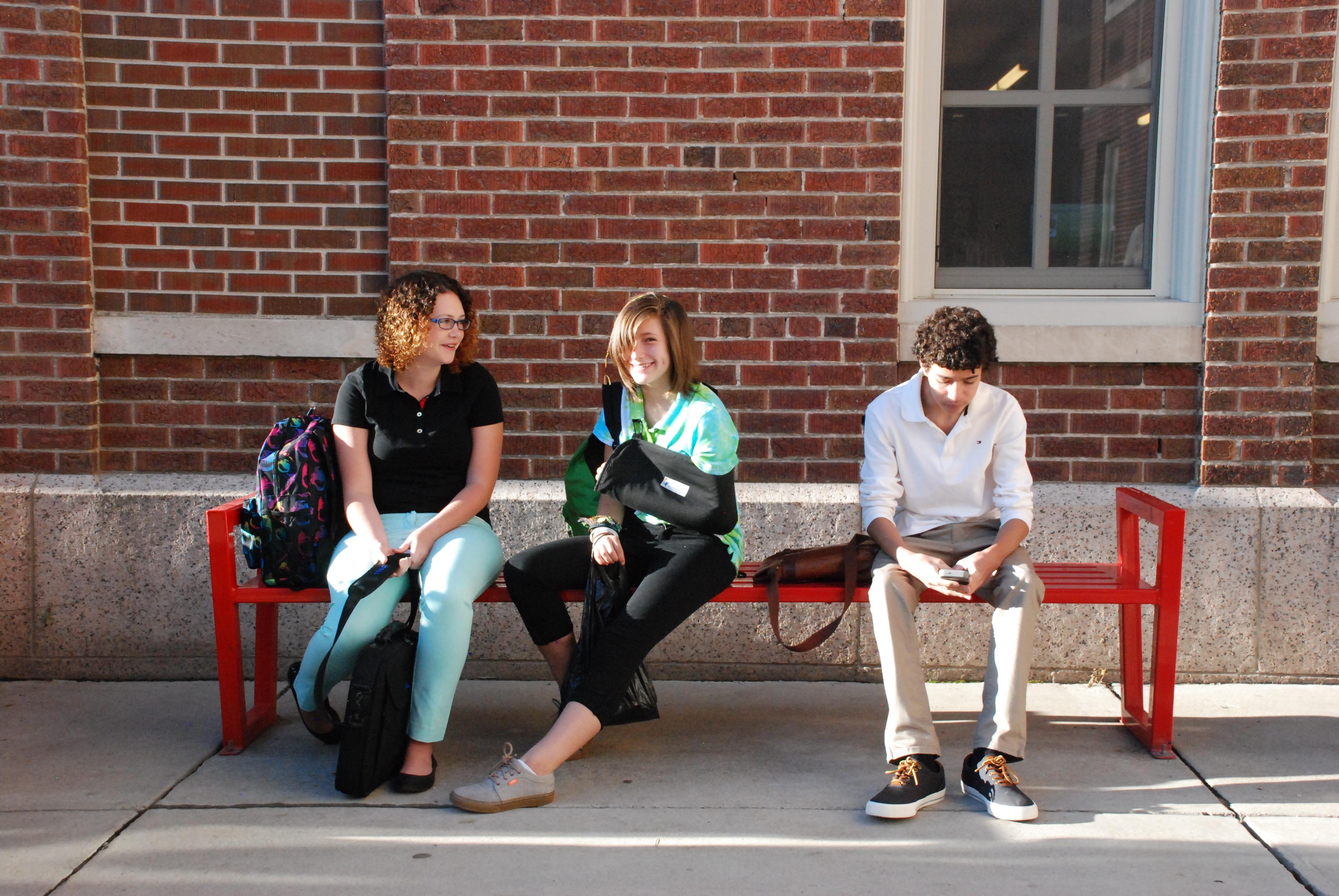 Freshman wait for school to start at DSST Cole High.