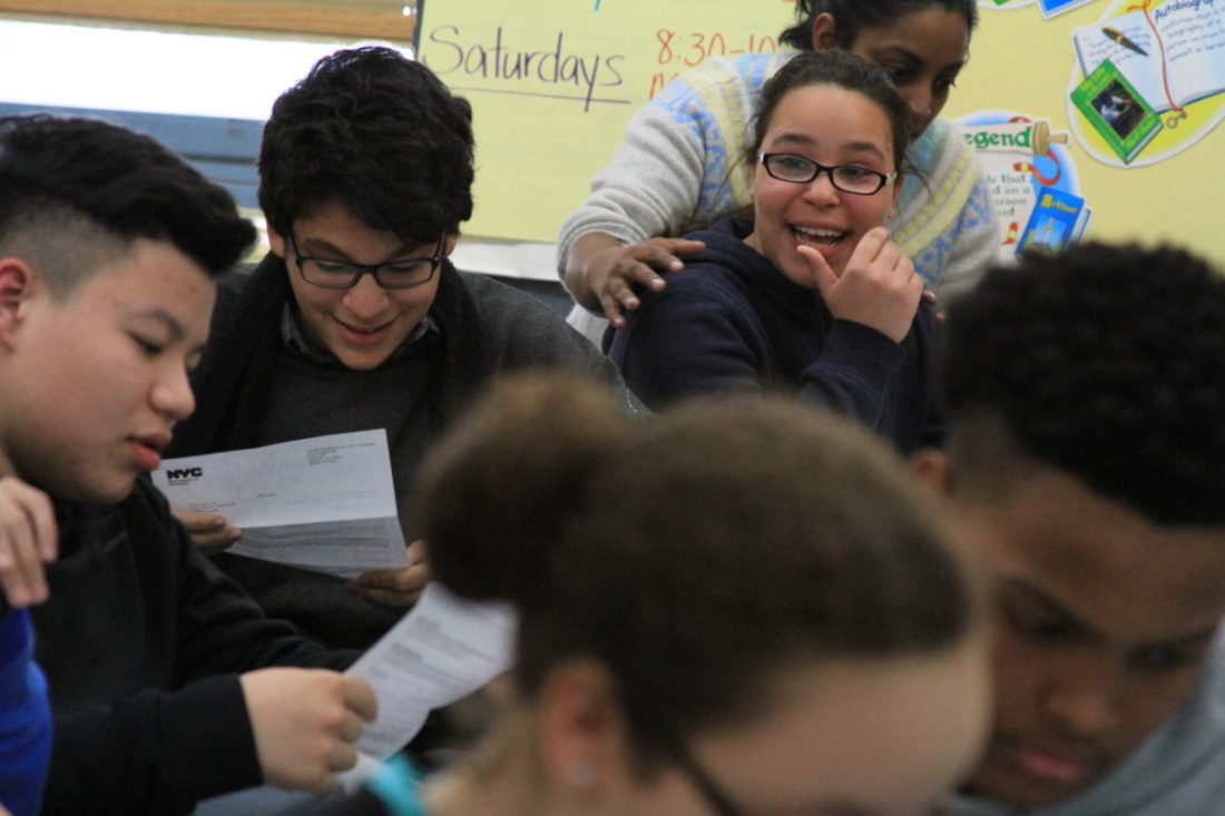 Eighth-grade students at M.S. 244 in the Bronx receive their high school admission letters in 2016.