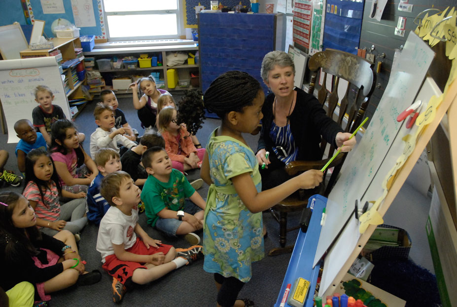 A teacher helps a student during classroom instruction at McClelland Elementary School.