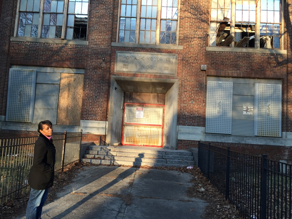Dawn Wilson stands outside one of the many neighborhood schools in Detroit that has been shut down.