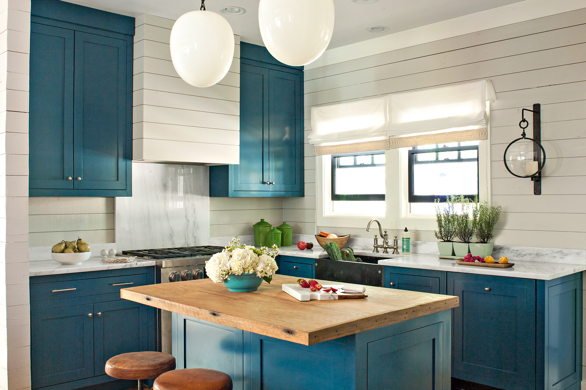 Refreshing kitchen with blue replacement kitchen cabinet doors.