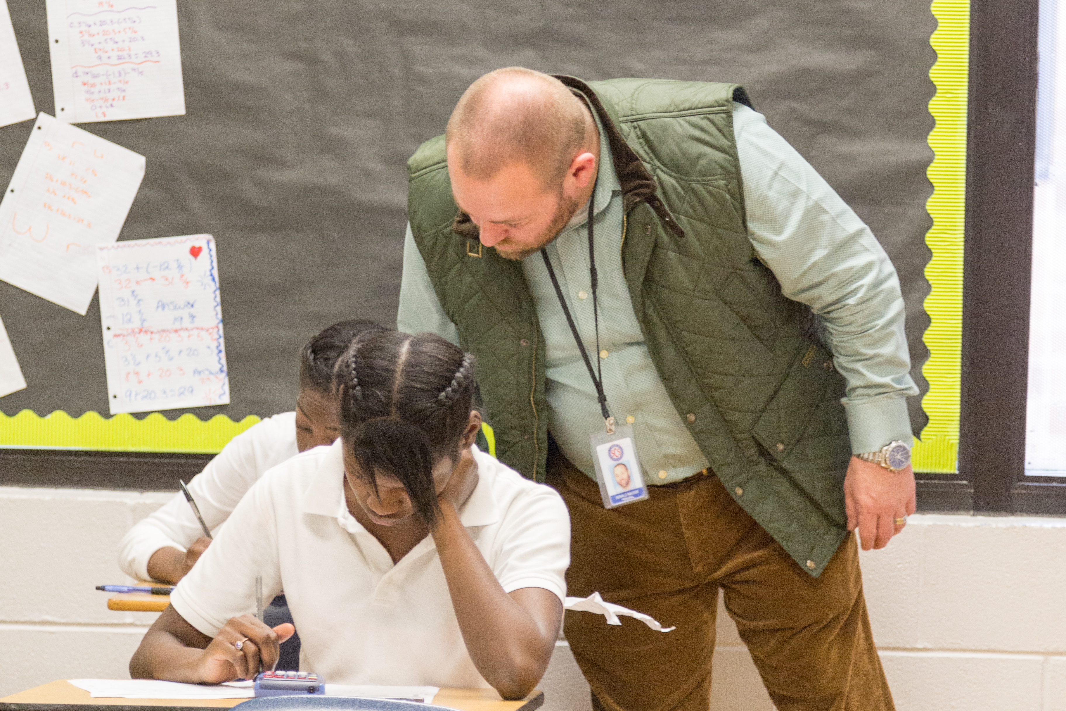 Ronnie Mackin checks on a student's work in 2016 when he was principal at Raleigh Egypt Middle School. Mackin was chief administrator the following school year at Trezevant High School, now the center of several investigations that started as a result of Mackin's allegations.