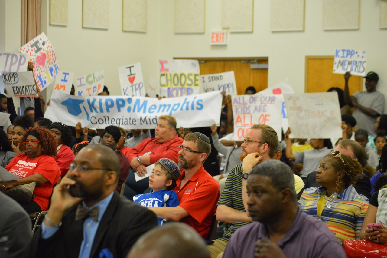 Supporters of KIPP charter schools in Memphis lobby for their schools to remain open during Tuesday evening's Shelby County school board meeting.