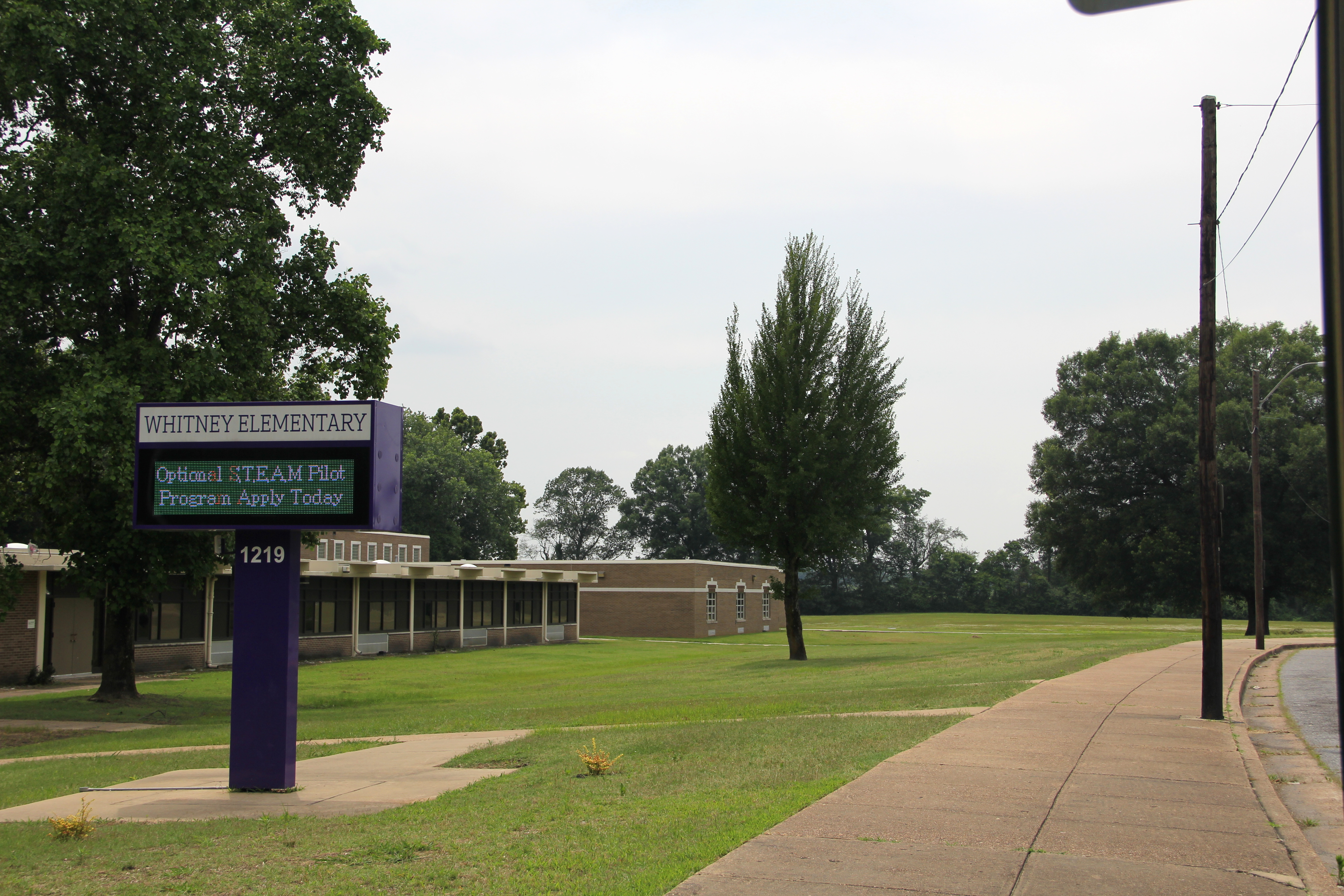 Whitney Achievement Elementary School, in the Memphis community of Frayser, is located adjacent to a field (behind the tree line) that is the site of a proposed demolition landfill.
