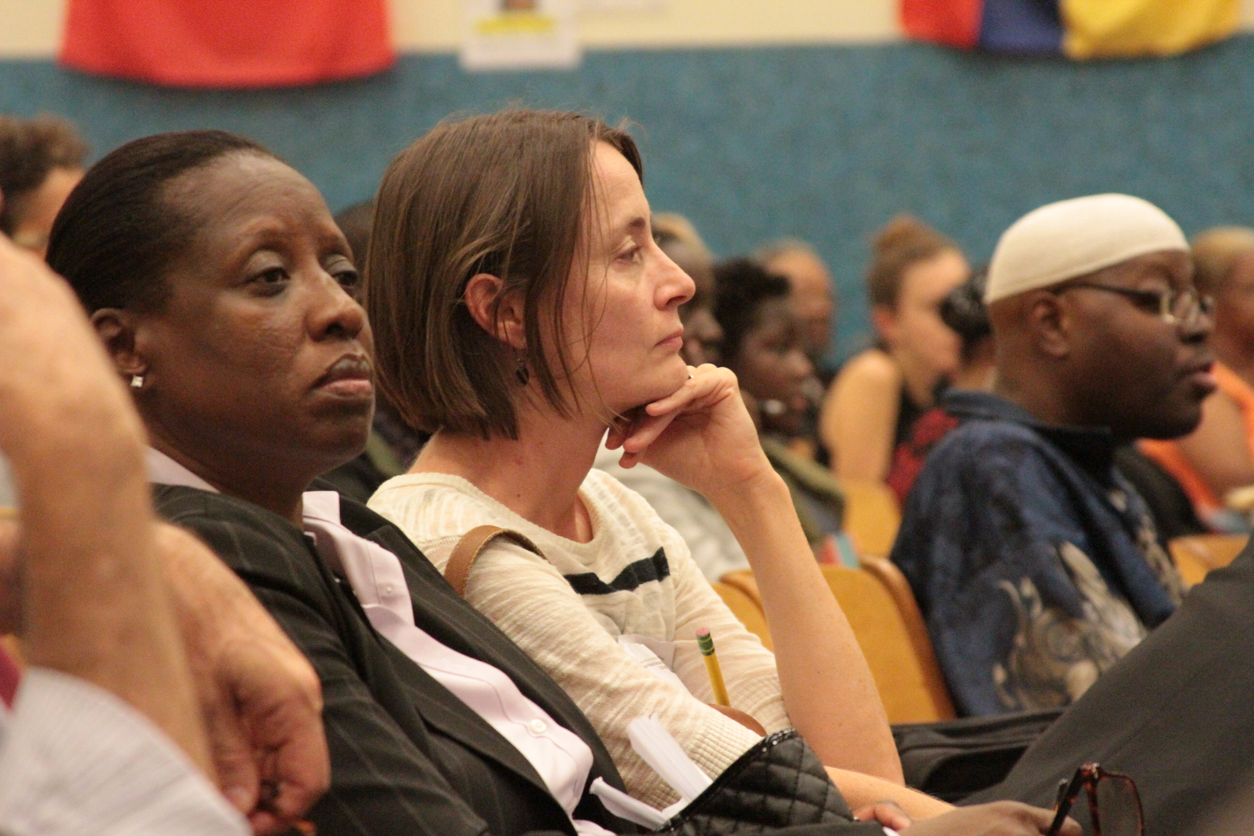 Parents and community members at a Community Education Council meeting for District 13.