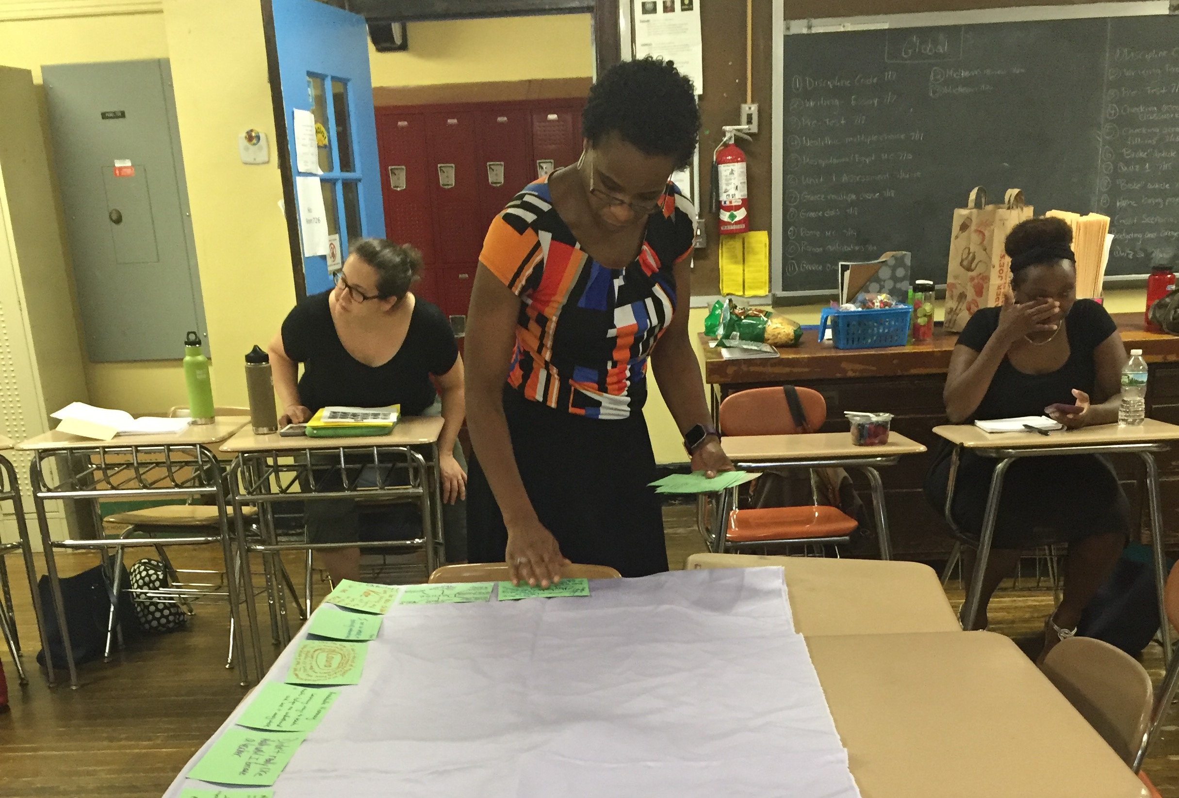 """Rajihah Coaxum making a version of the """"centerpiece"""" for teachers participating in the NYC Math Lab."""