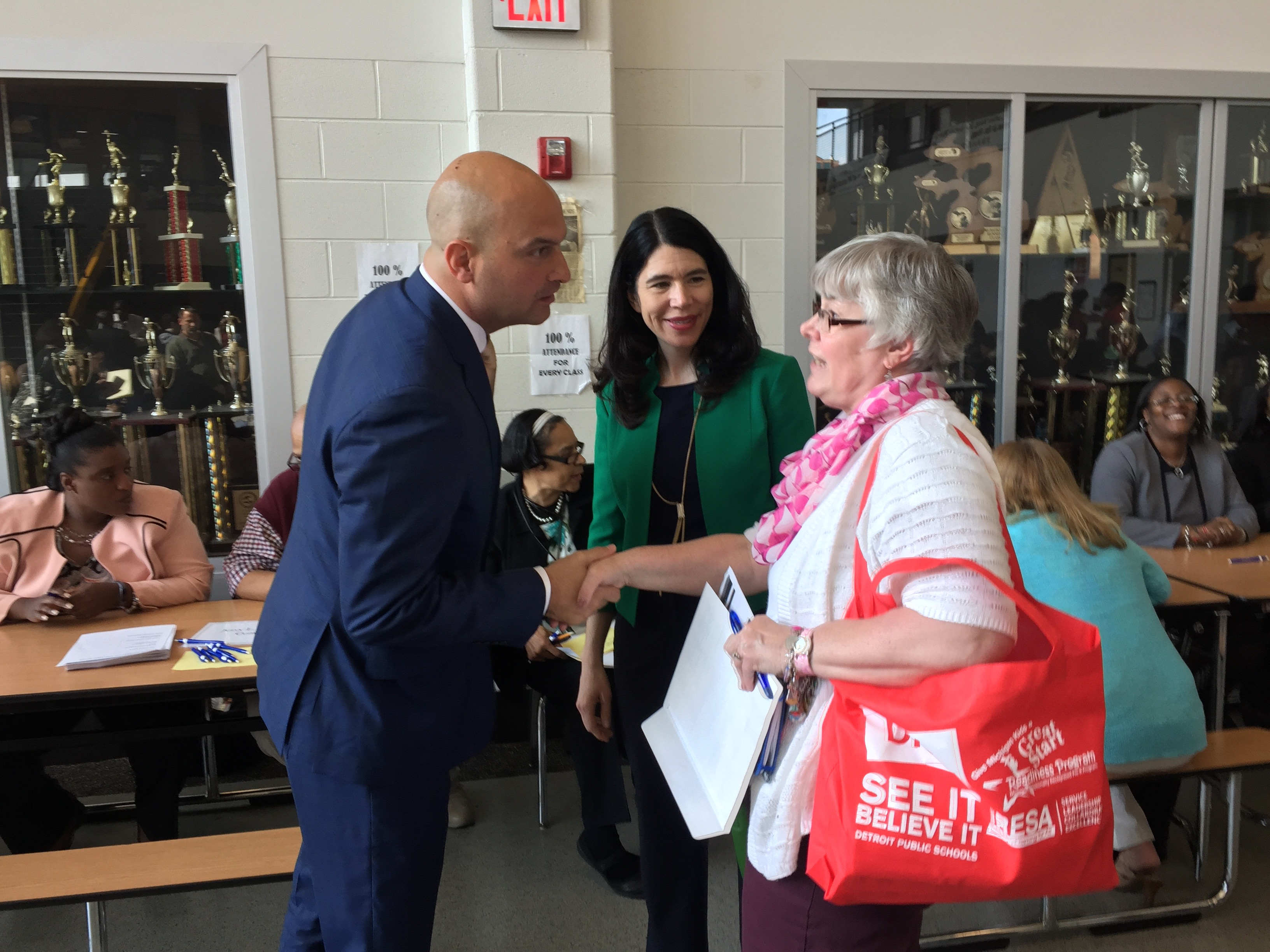 Detroit superintendent Nikolai Vitti named his first deputy, former Interim Superintendent Alycia Meriweather, center. She introduced Vitti in May as he met with principals and applicants at a job fair.