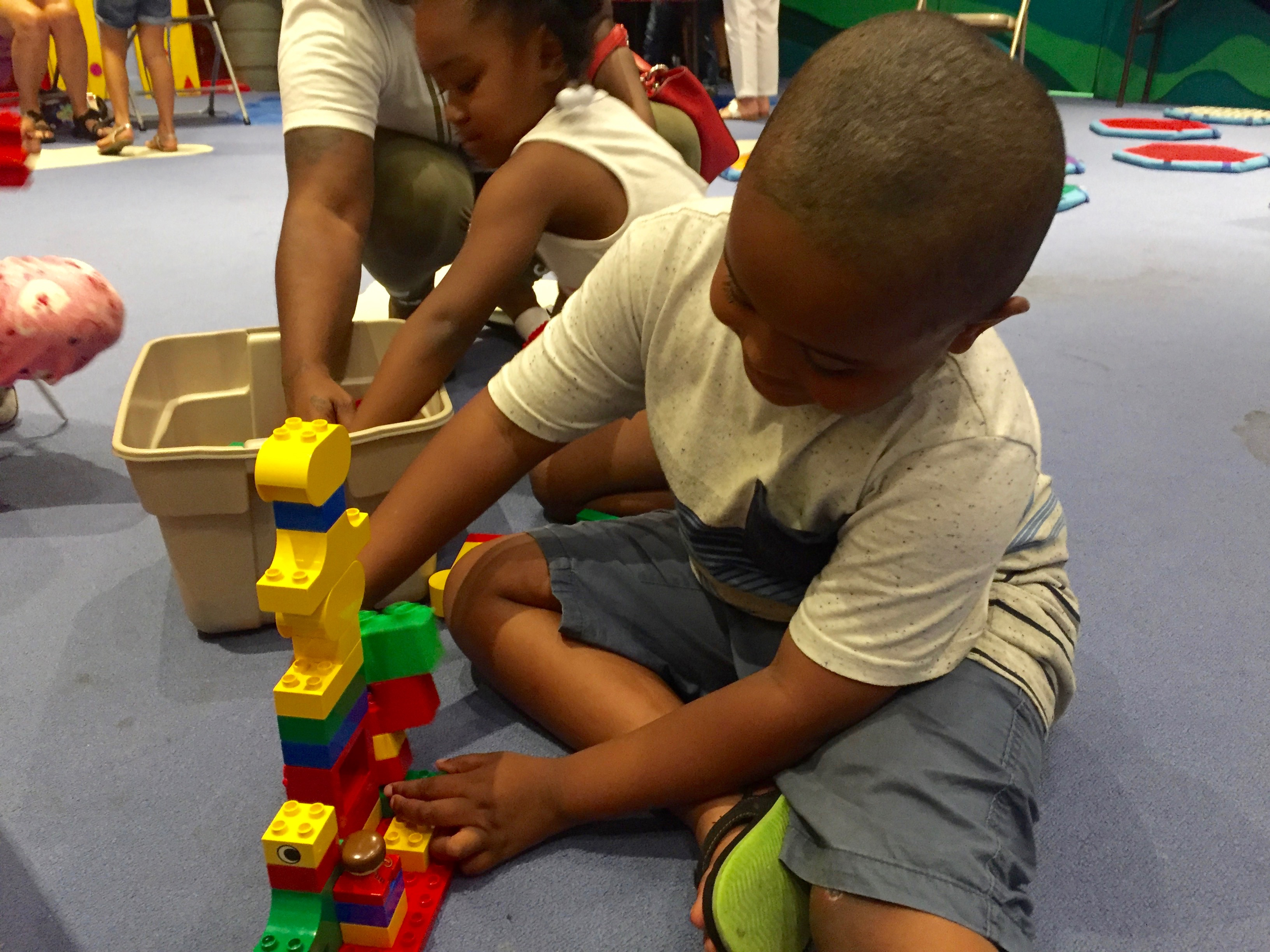 Torrence Echols, a rising first-grader in Memphis, builds a tower with giant legos at the Benjamin L. Hooks Library on National Summer Learning Day.
