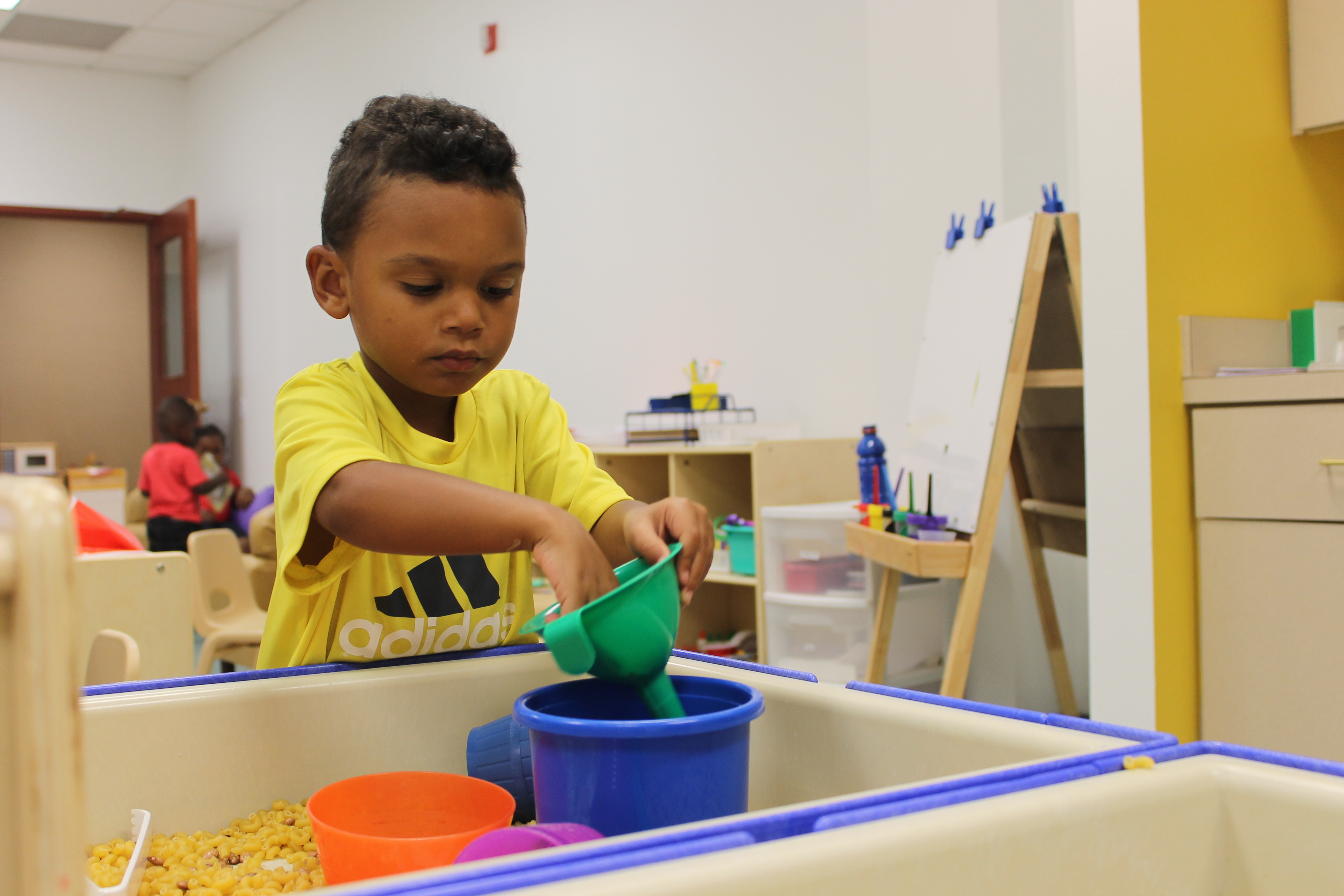 Three-year-old Ra'Jon Whitaker plays at a sensory center in his preschool classroom at Day Early Learning at Eastern Star Church.