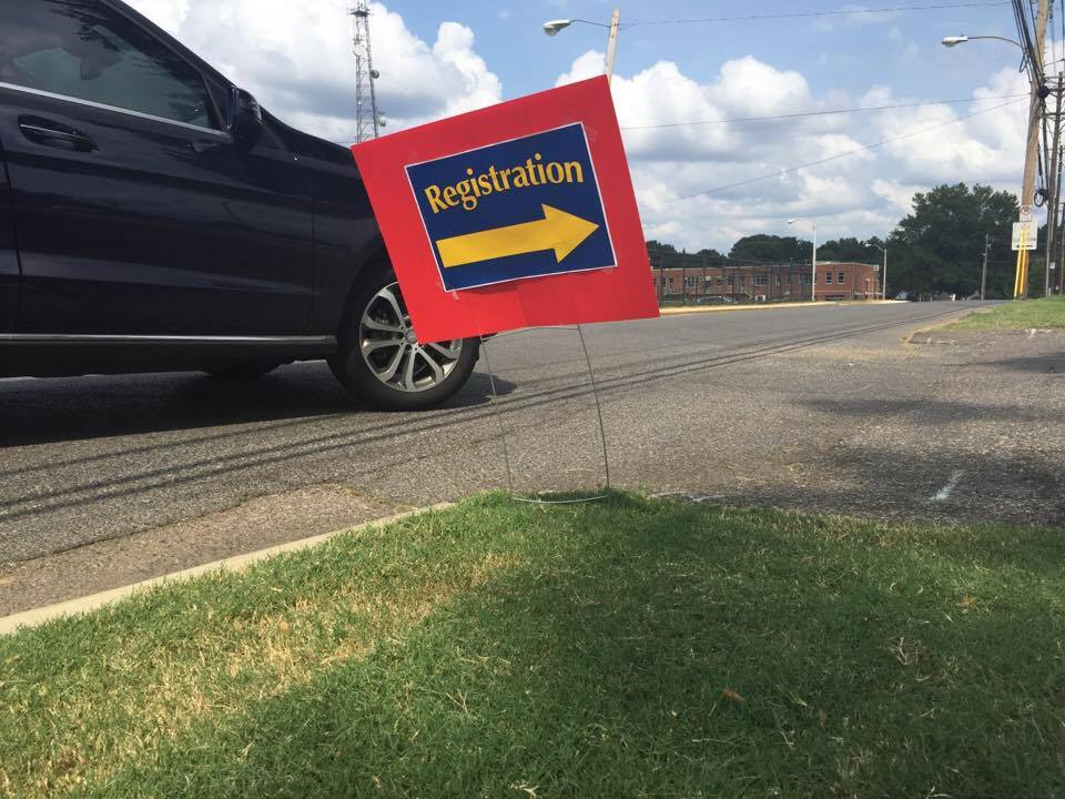 A sign points the way to a registration event inside the headquarters of Shelby County Schools.