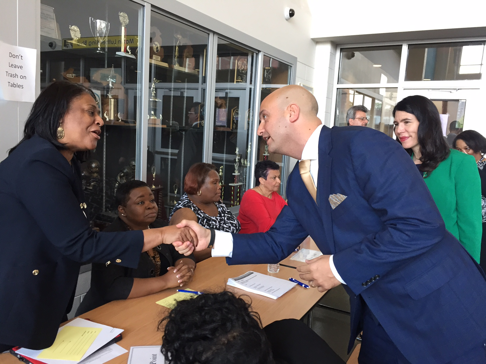 On his first day as Detroit schools superintendent, Nikolai Vitti, with former interim superintendent Alycia Meriweather, greets principals at a teacher hiring fair at Martin Luther King Jr. High School.