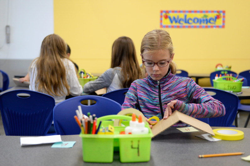 Allison Pippert, 10, constructs a name plate during her fifth-grade class at Stargate School (Photo by Anya Semenoff/The Denver Post)
