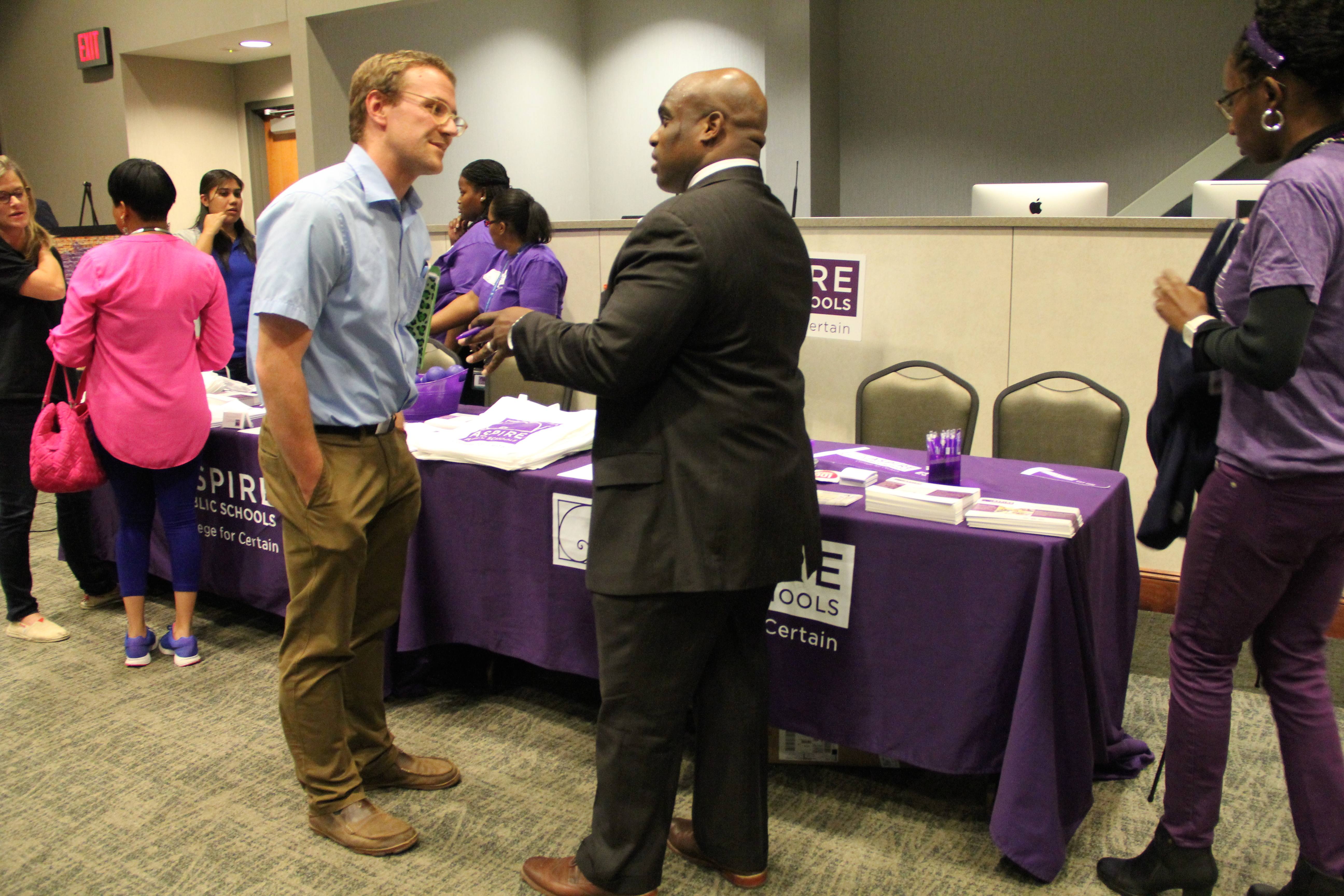 """Nickalous Manning (right) represents Aspire Public Schools at a """"Meet the Operators Fair"""" sponsored Oct. 8 in Memphis by Tennessee's Achievement School District."""