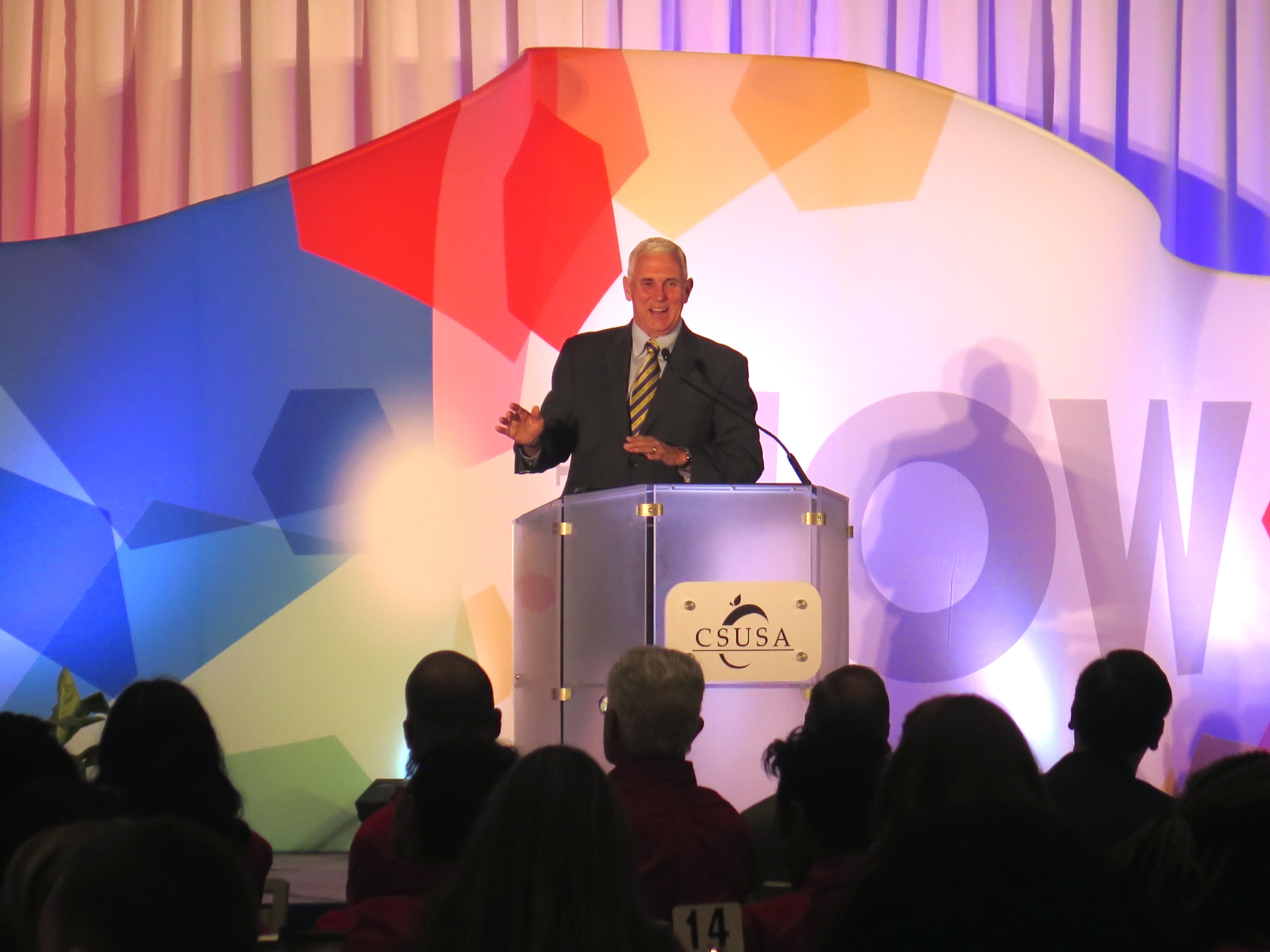 Gov. Mike Pence addresses a crowd of teachers and leaders from Howe and Manual high schools and Donnan, which is now a K-8 school, during Charter Schools USA's annual summit at the Westin Hotel downtown.
