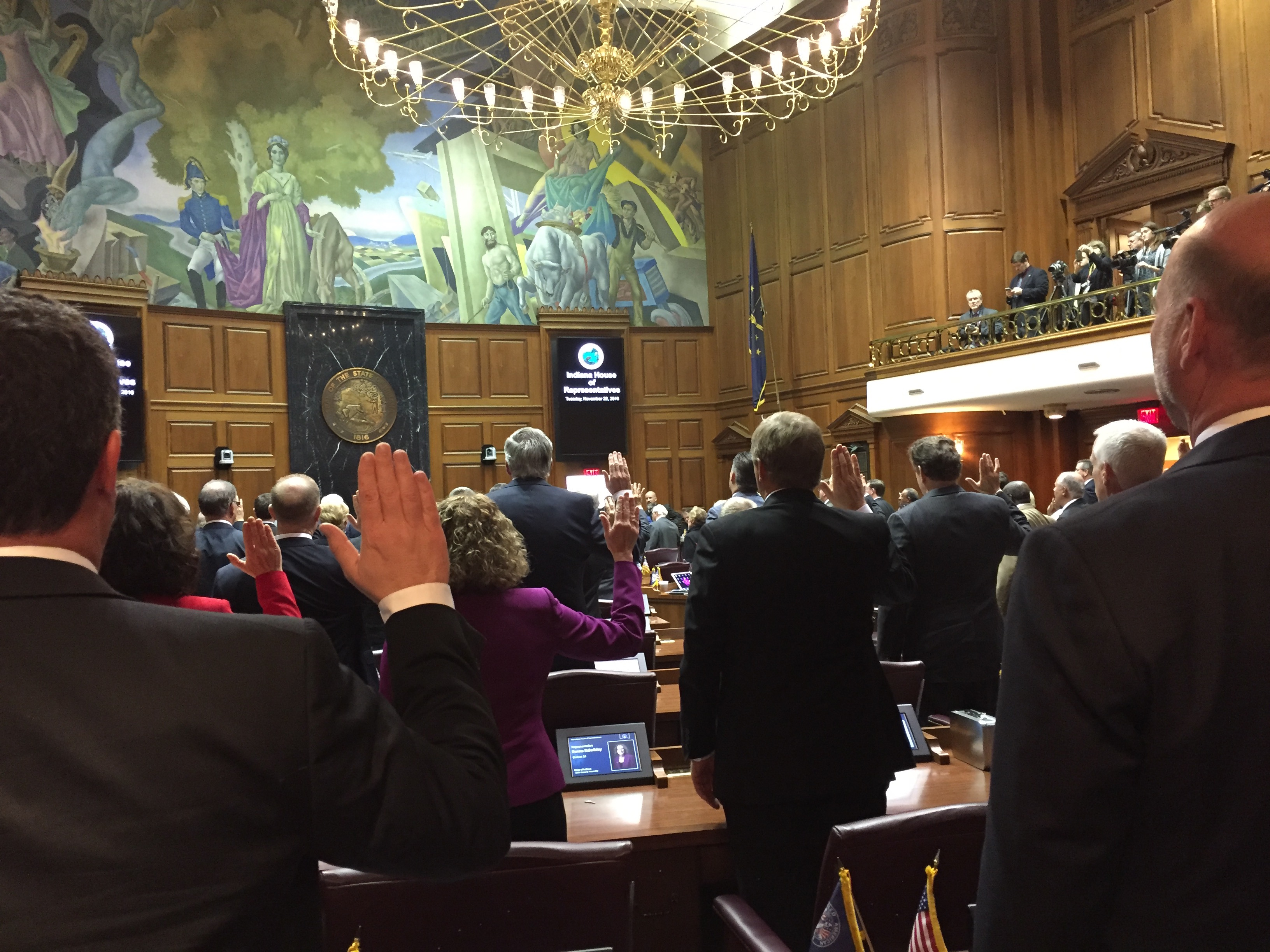 Indiana House Speaker Brian Bosma, R-Indianapolis, (right) and Rep. Todd Huston, R-Fishers, take the oath of office along with the rest of the House members during the annual Organization Day session to officially begin the 2017 legislative session.