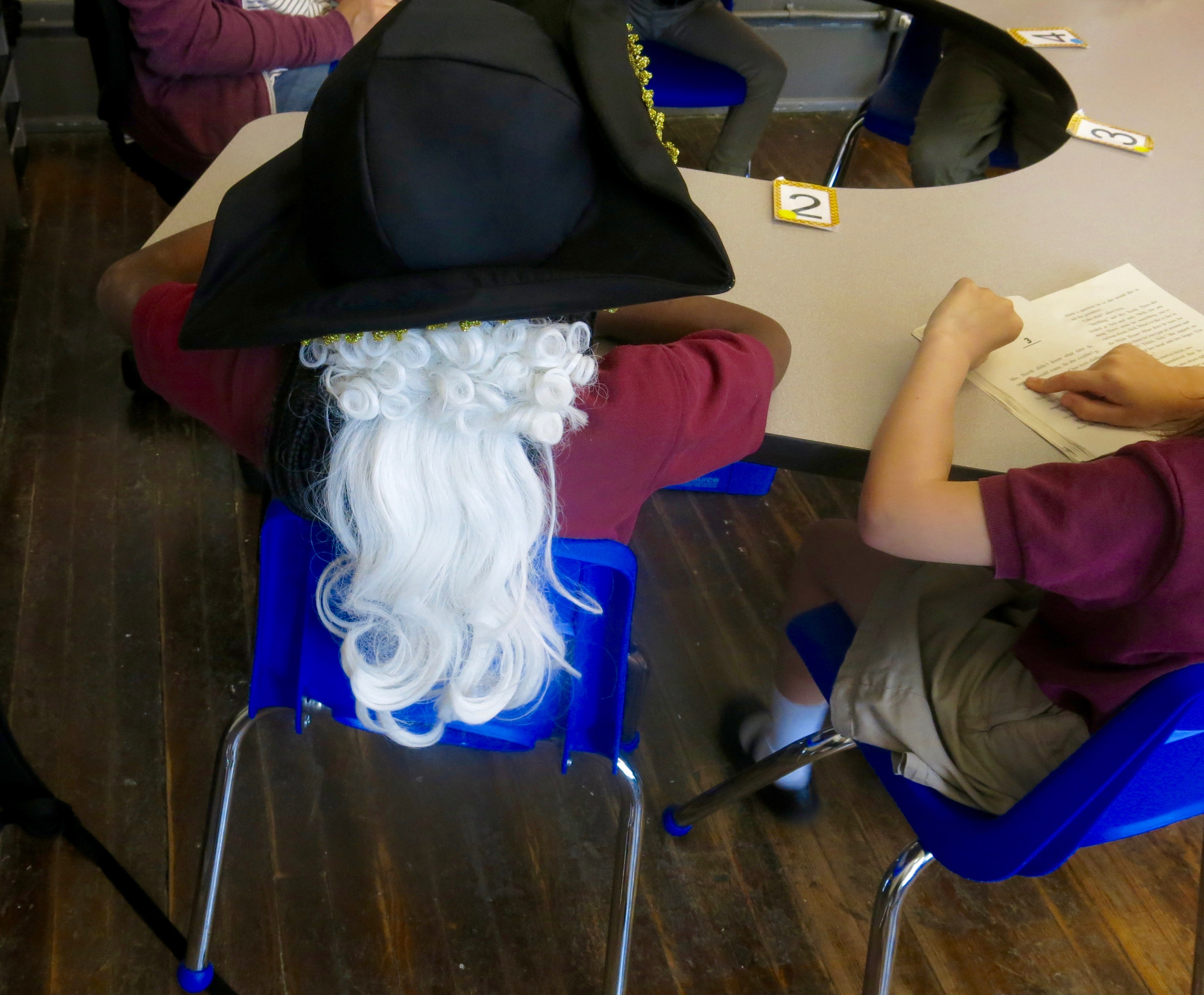 A first-grader at Nashville Classical Charter School wears a Colonial-era hat after history class. A new proposal would require all Tennessee students take a full semester of state-specific history at some point in their education.