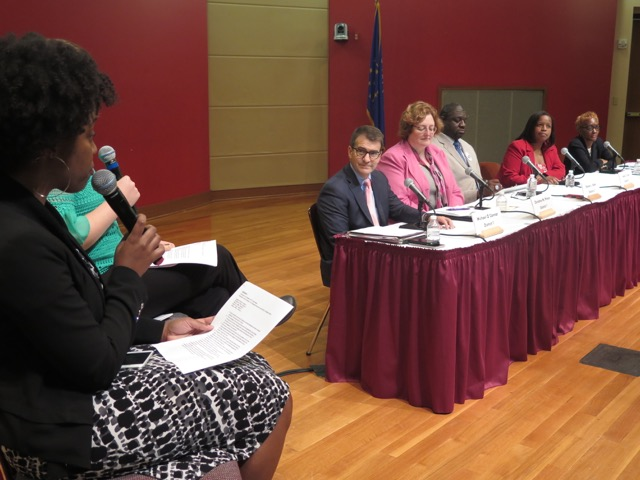The Indianapolis Recorder's Ebony Chappel asks a question to candidates for IPS school board at Wednesday's candidate forum.