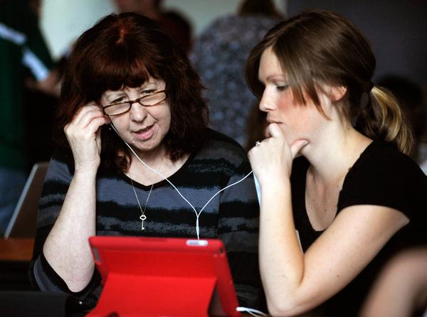 Manitou Springs educators Julie Adams and Denise Dibbons get introduced to an iPad in 2011 (Andy Cross, The Denver Post).