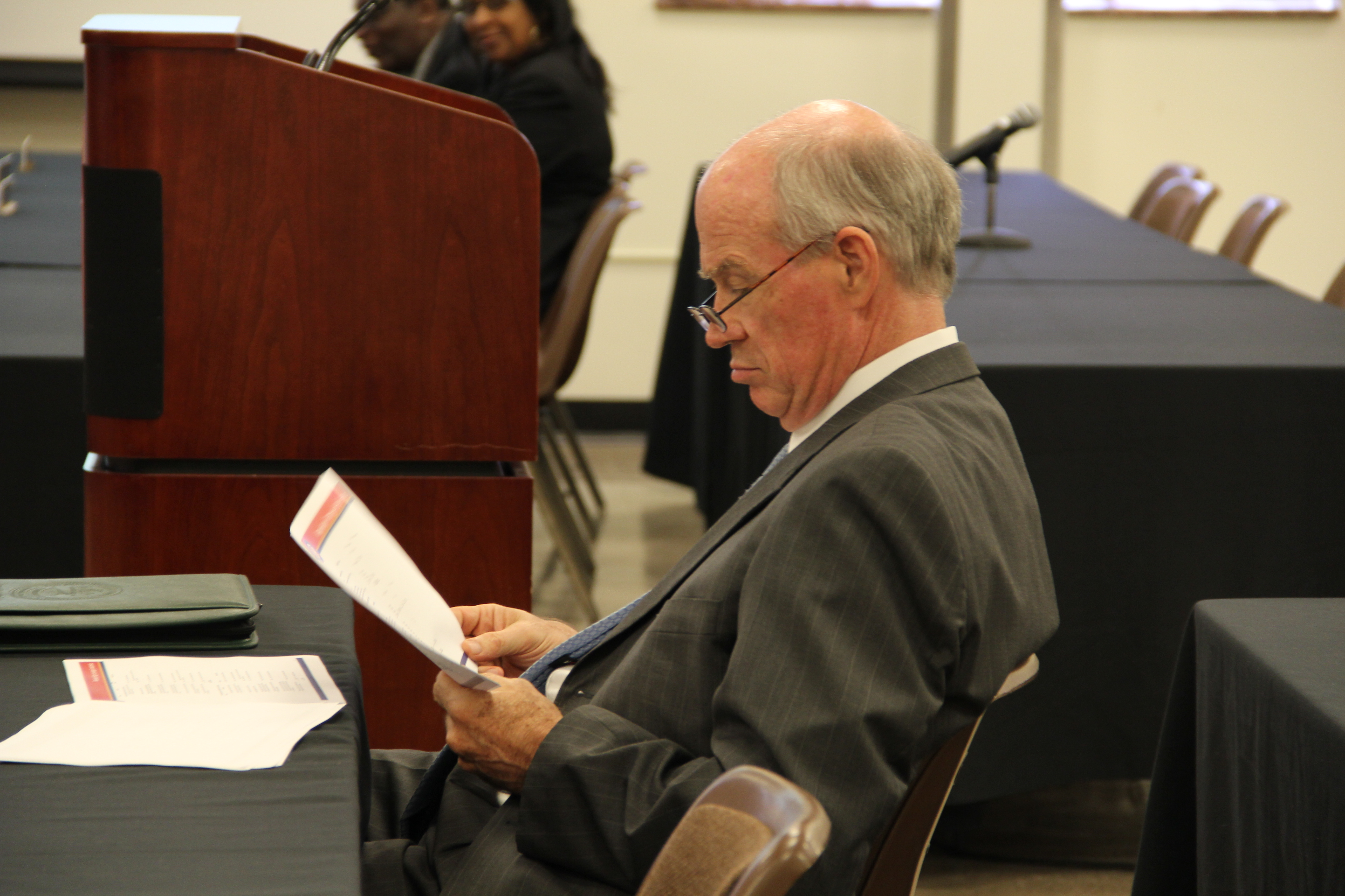 Shelby County budget director Mike Swift studies information presented by leaders of Shelby County Schools during a budget hearing on July 5.
