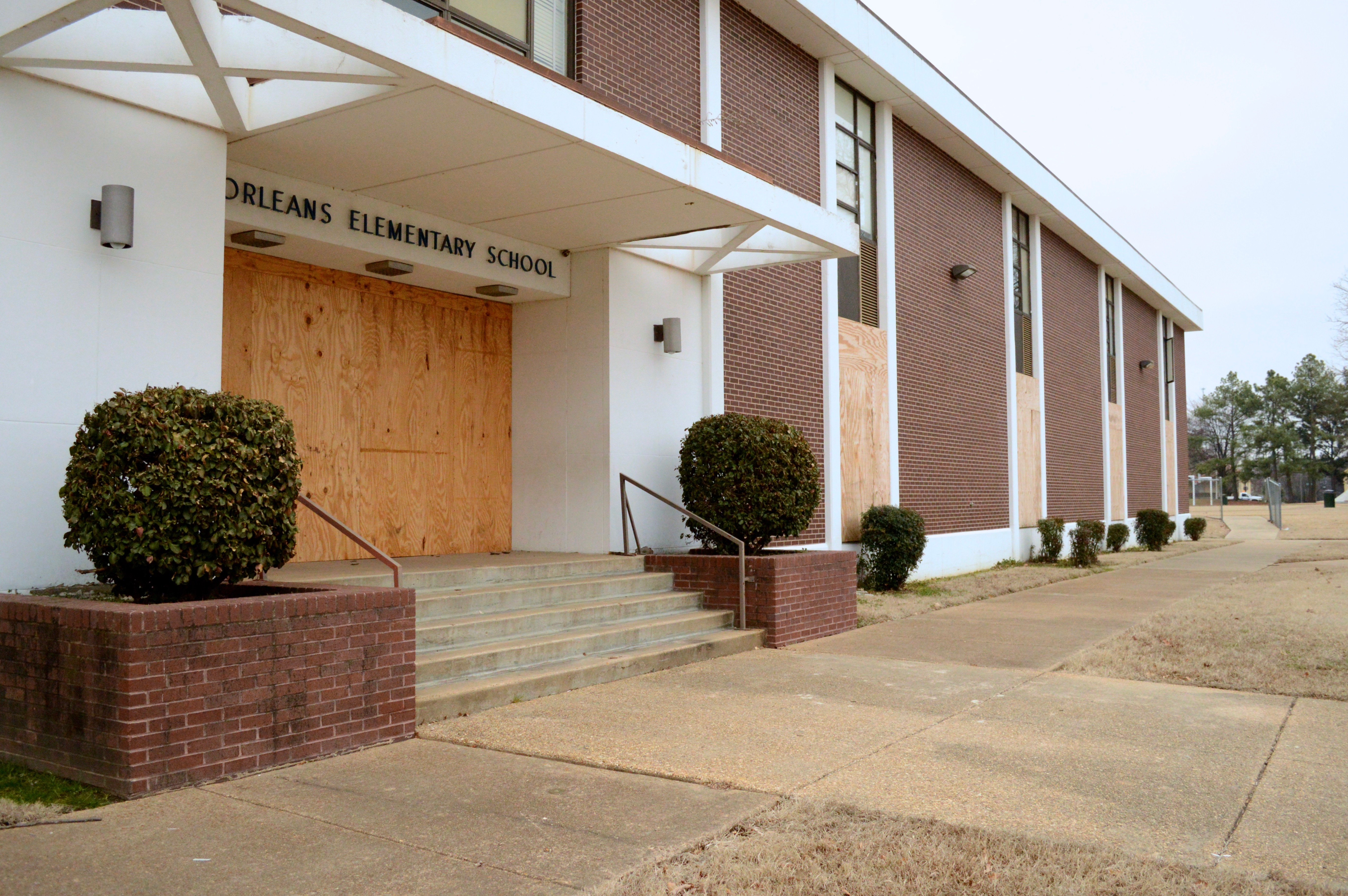 A boarded-up Orleans Elementary School is among Memphis schools closed since 2012.