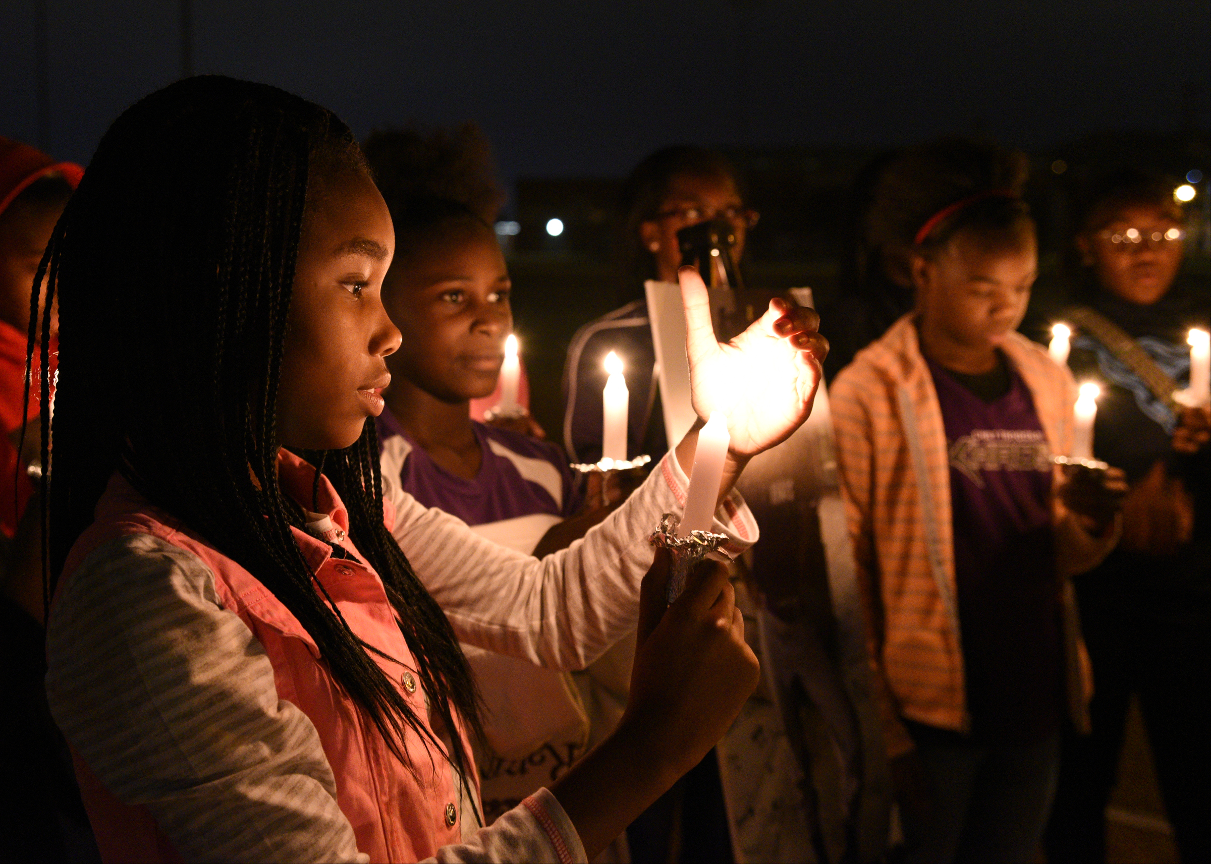 Ma'Liyah Montgomery participates in a candlelight vigil on Nov. 23, 2016, to remember Zoie Nash, one of six elementary school students killed that week in a school bus crash in Chattanooga, Tenn.