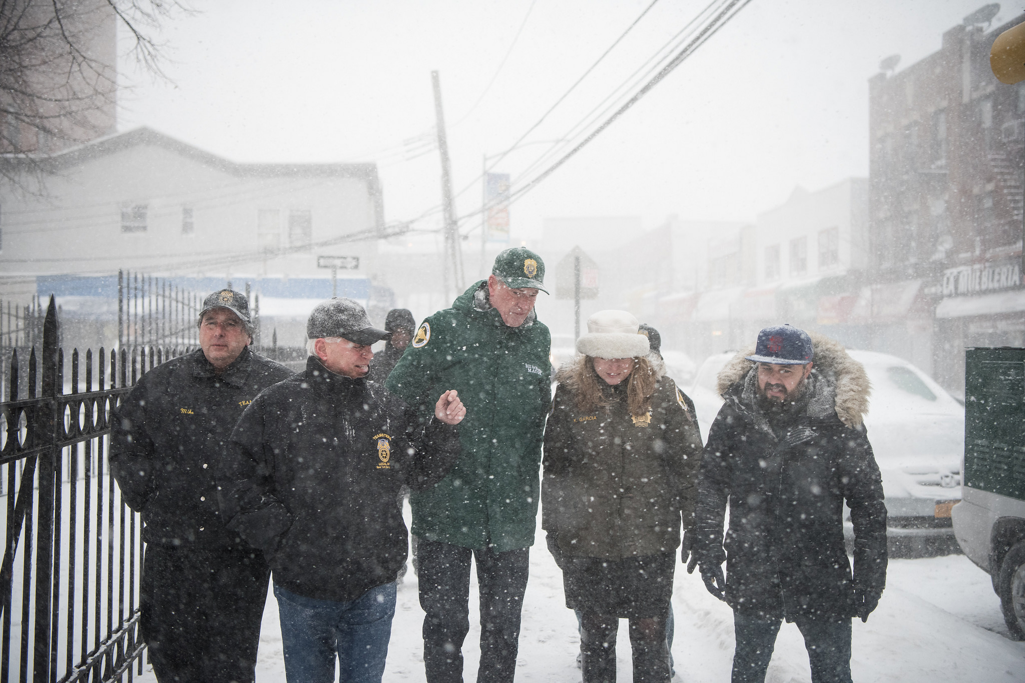 Mayor Bill de Blasio toured a snow-covered neighborhood in Queens with other city officials Thursday.