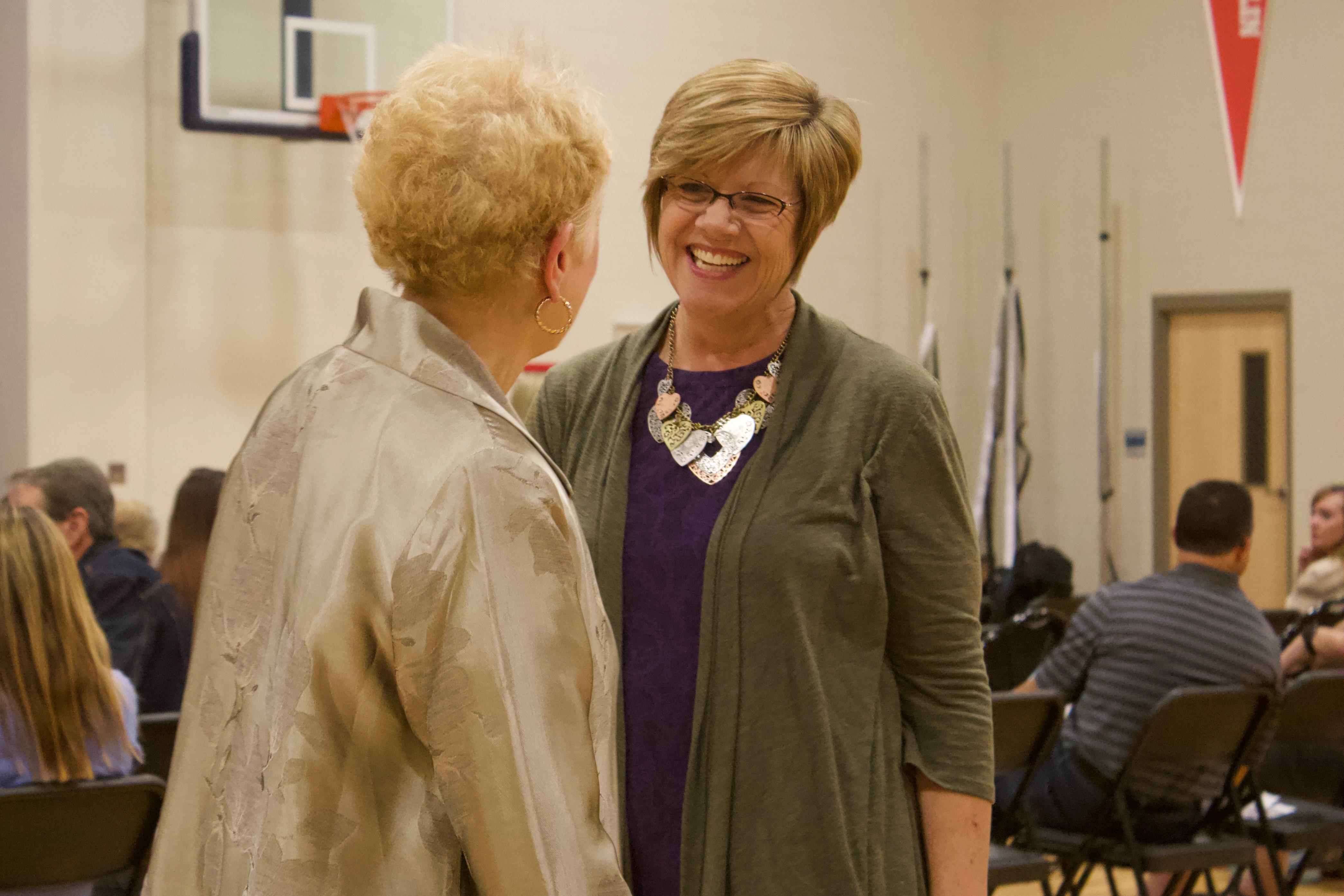 Pam Mazanec, right, greets former state board member Debora Scheffel at a Douglas County school board forum in November 2017. (Photo by Nic Garcia)