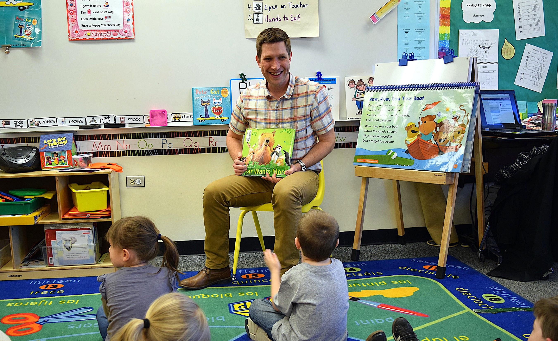 Dan Haught, a speech-language pathologist at Mesa Elementary School in Westminster Public Schools, with children in a preschool classroom.