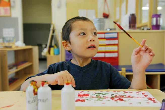 Josiah Berg, 4, paints a picture at Mile High Montessori, one of more than 250 Denver preschools that are part of the Denver Preschool Program.
