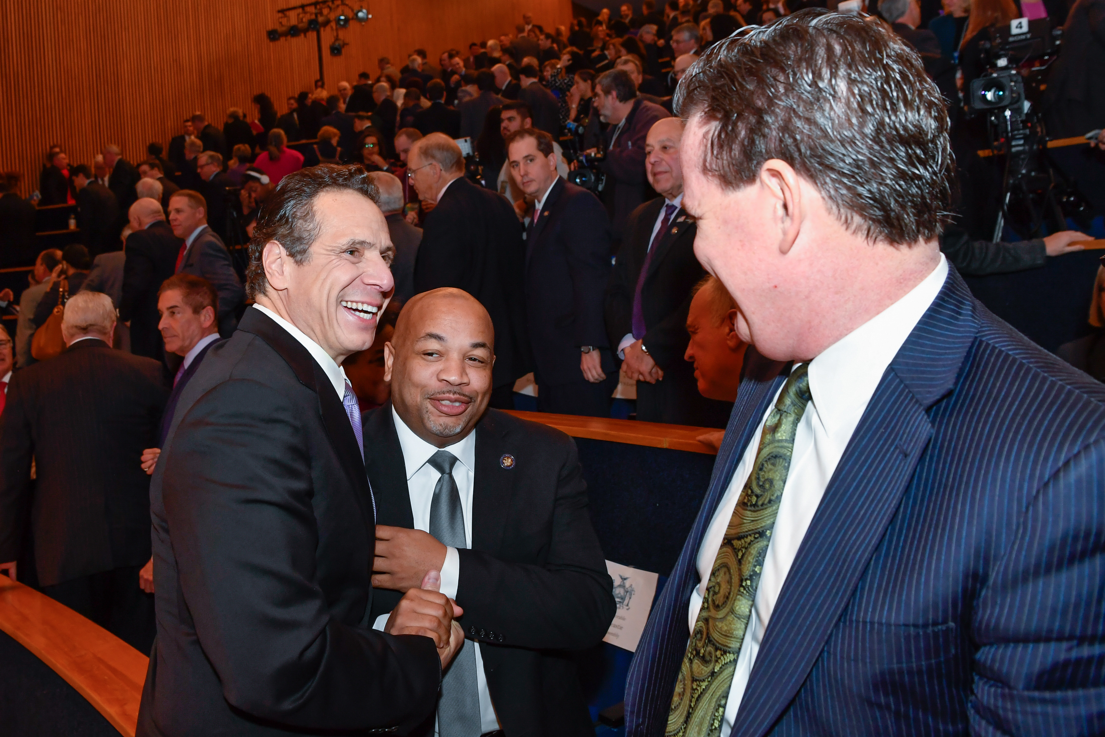 Governor Cuomo shakes hands with Assembly Speaker Heastie after his executive budget address.