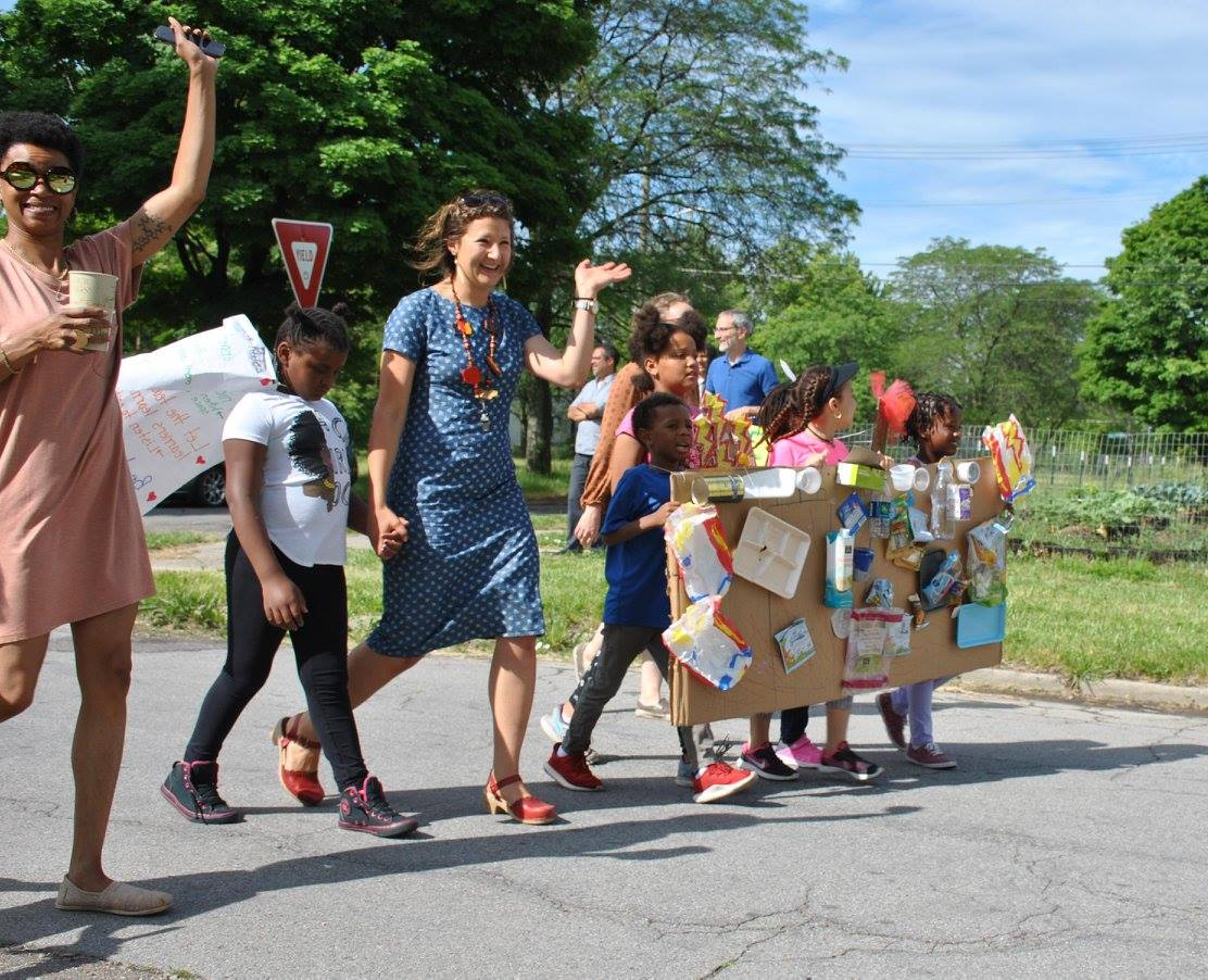 Teacher Kelly Rickert of the James and Grace Lee Boggs school, leads her students, wearing an incinerator costume, in a parade as part of lesson on trash and pollution.